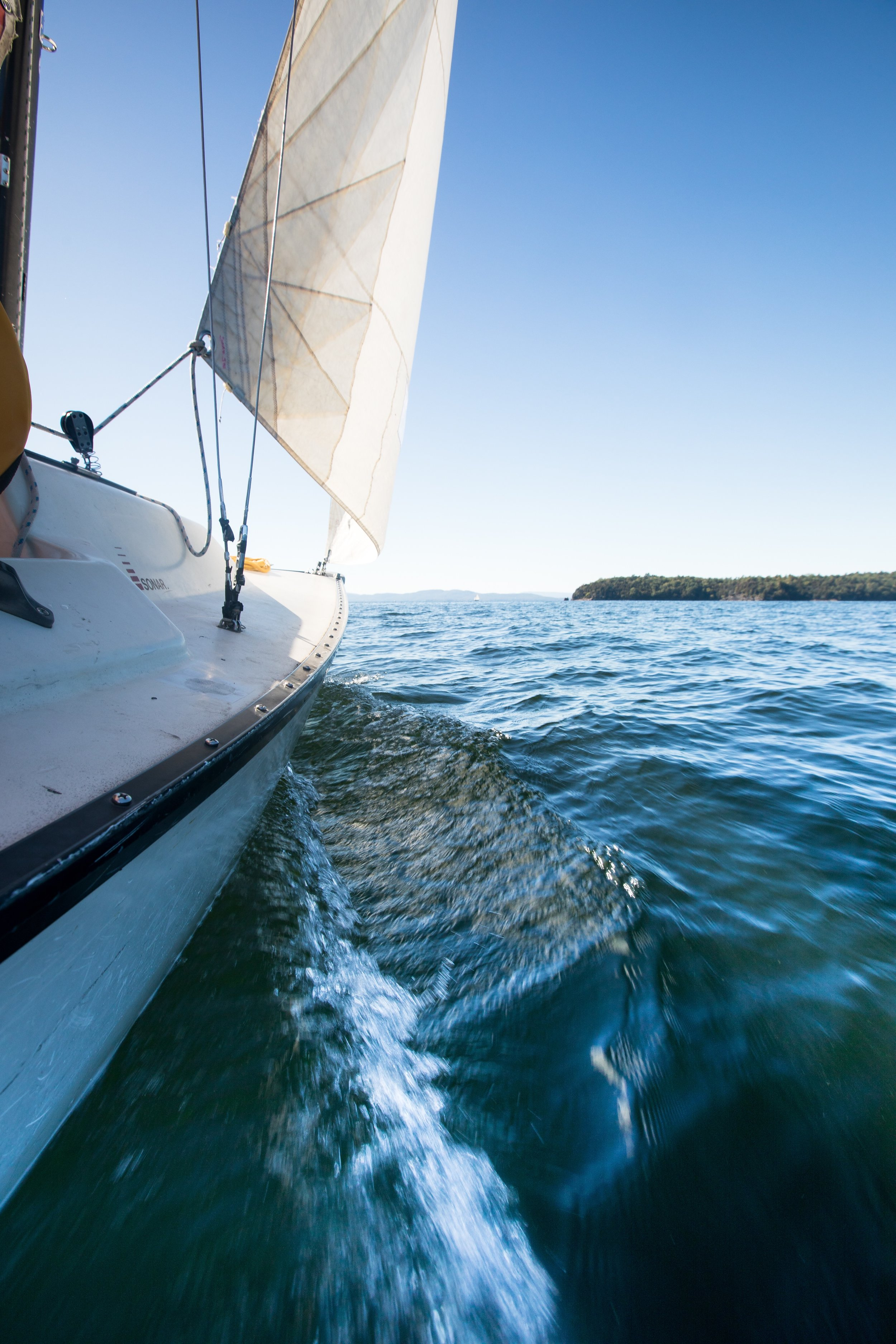 ABOUT US - Halyard: a rope used for raising and lowering a sail.