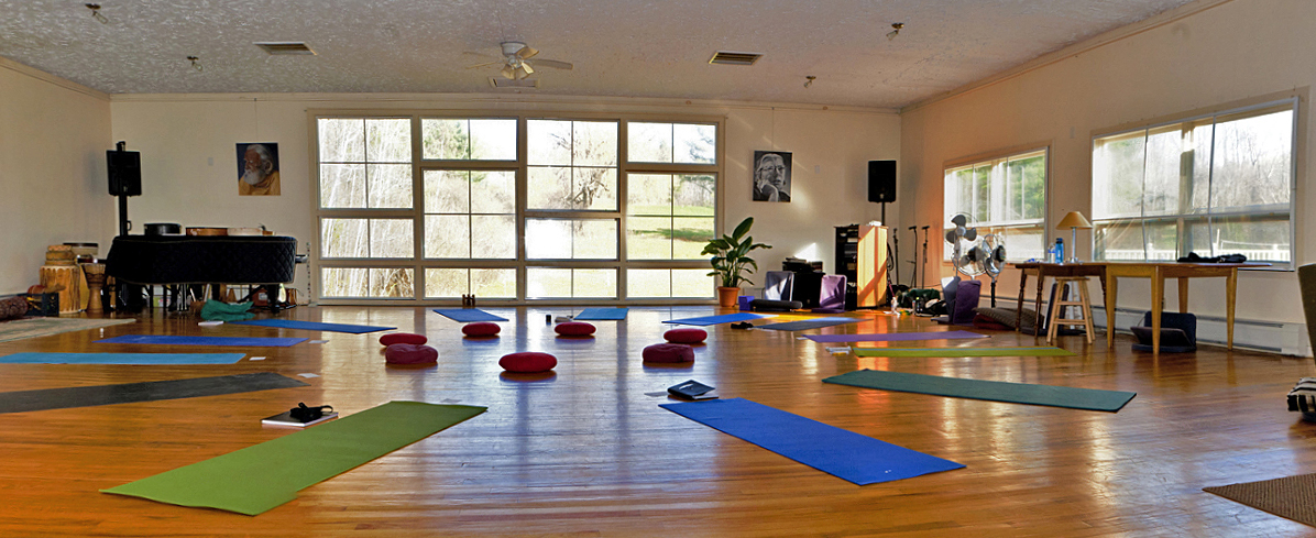 Yoga mats and cushions arranged in a circle in the Great Room