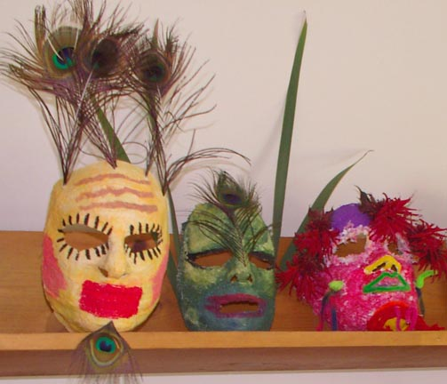 Three masks on a shelf