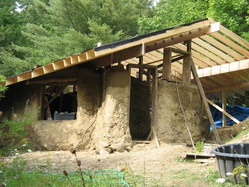 Mud structure with unfinished wooden roof