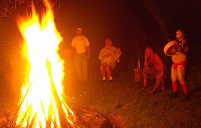 Men in circle around bonfire