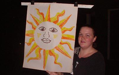 Woman holding Sun banner