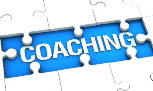 The word coaching, portrayed aa a jigsaw puzzle