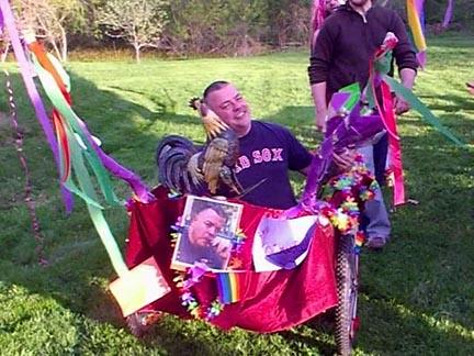 Tim sitting in a decoraed garden cart