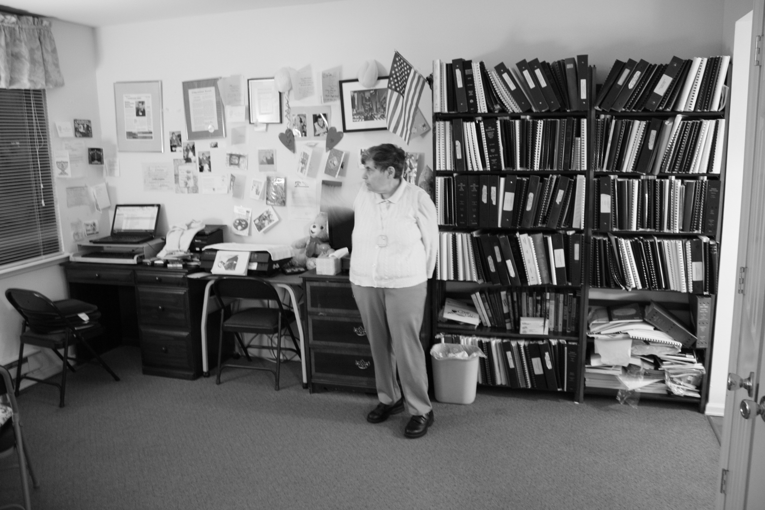 Cynthia showcasing her office and bookshelf