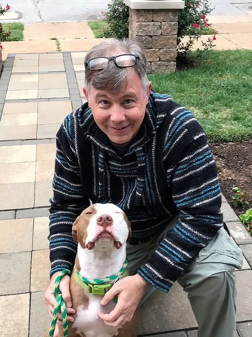 Michael Allbritton with his foster Pit Bull Toby