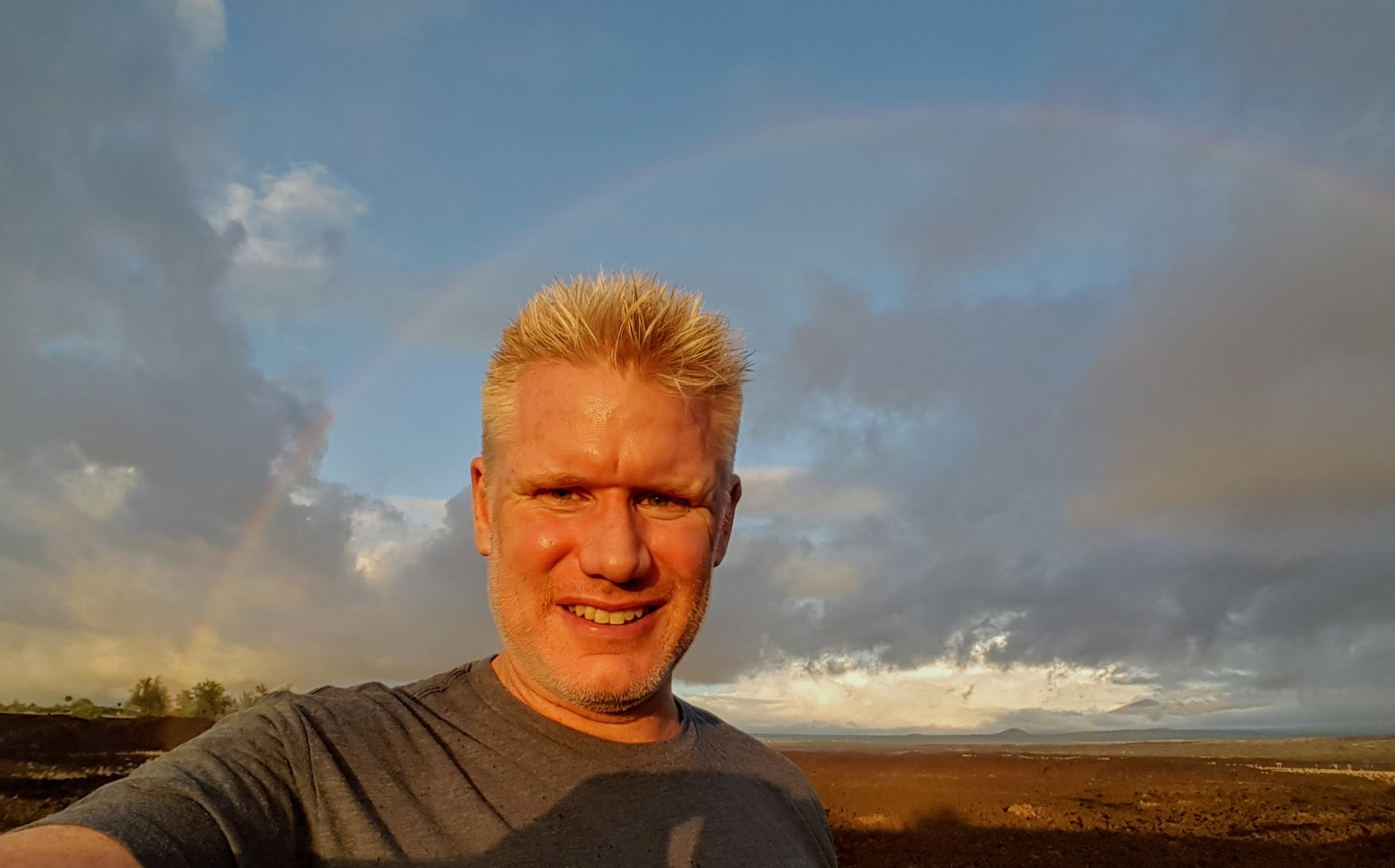 Christian, catching a rainbow on the Big Island of Hawaii (Kona)