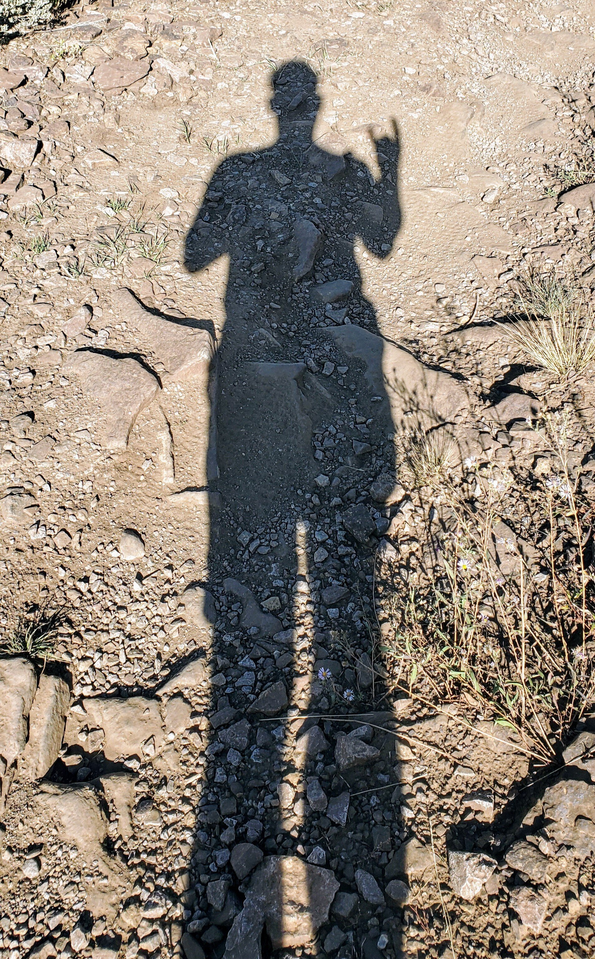 Christian's shadow during a hike in Utah