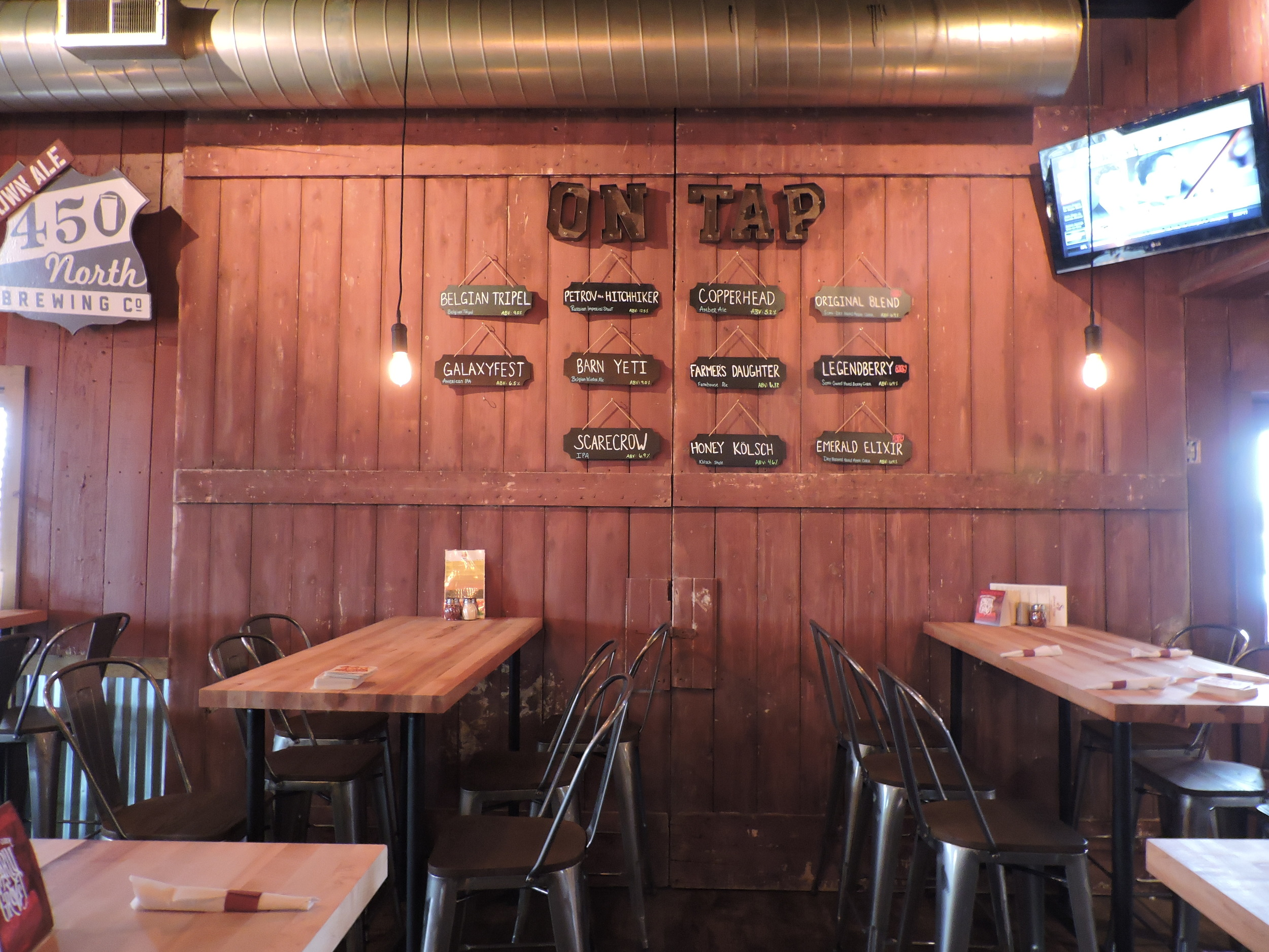 Reclaimed Barn Doors now a wall covering at Simmon's Winery/ 450 N Brewing Company, 8111 E 450 N, Columbus, IN 47203