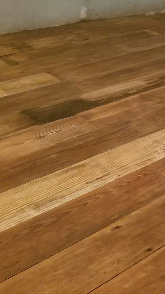 The back of barn siding creates a beautiful wood flooring. This is just sanded and not even finished yet.