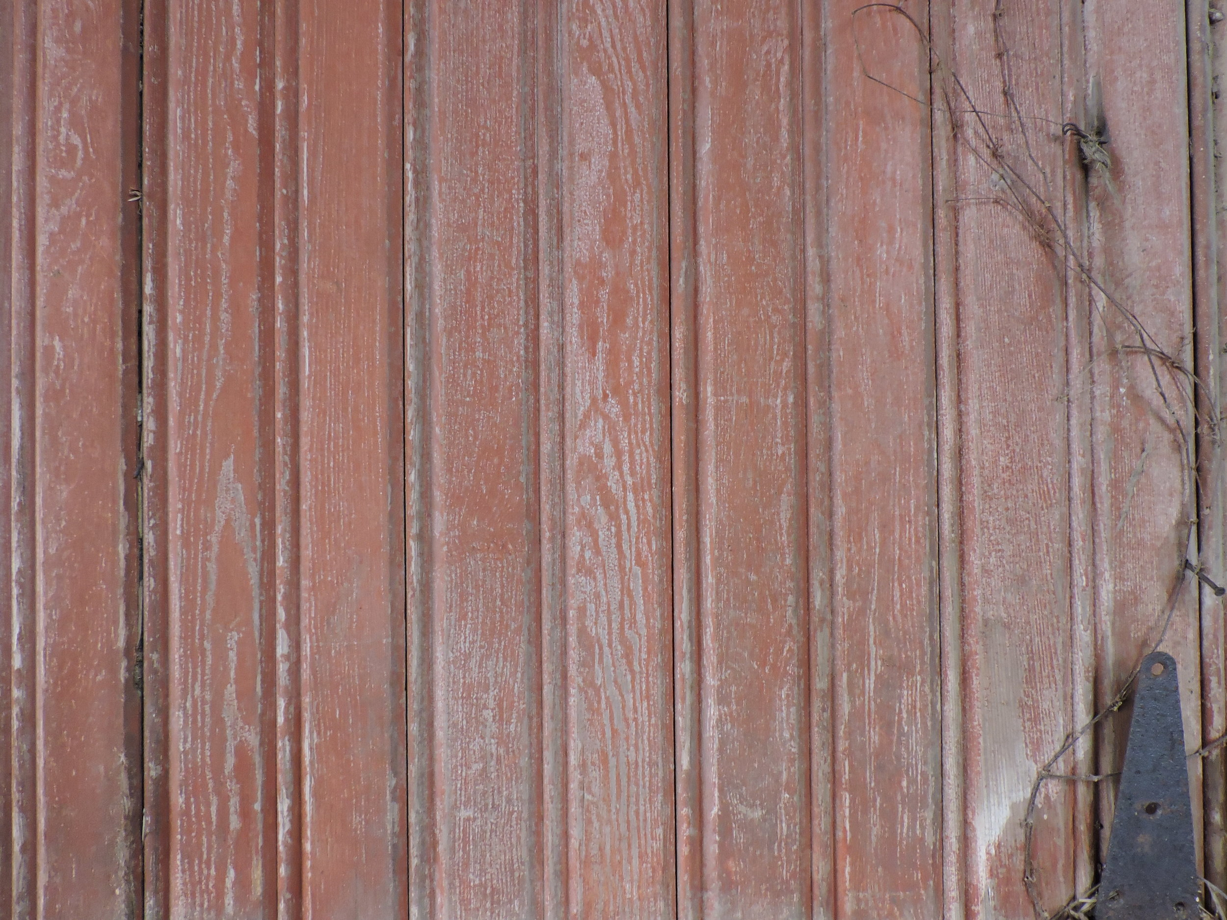 Red weathered siding with the bead down the center. & inches wide ship-lap.