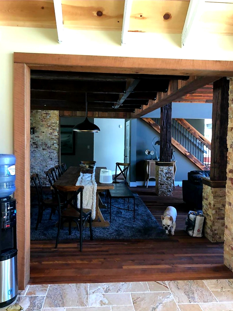 Across the room make sure you see the beautiful stair railing. It is created with white pine from the B and O Railroad along with metal rods from an old draft horse barn. 100 % reclaimed beauty. And what a sweet puppy!