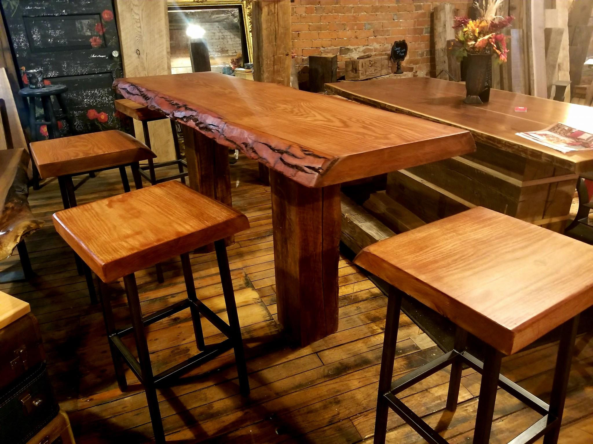Beautiful Live Edge bar area with steel based live edge stools- Custom orders always accepted.