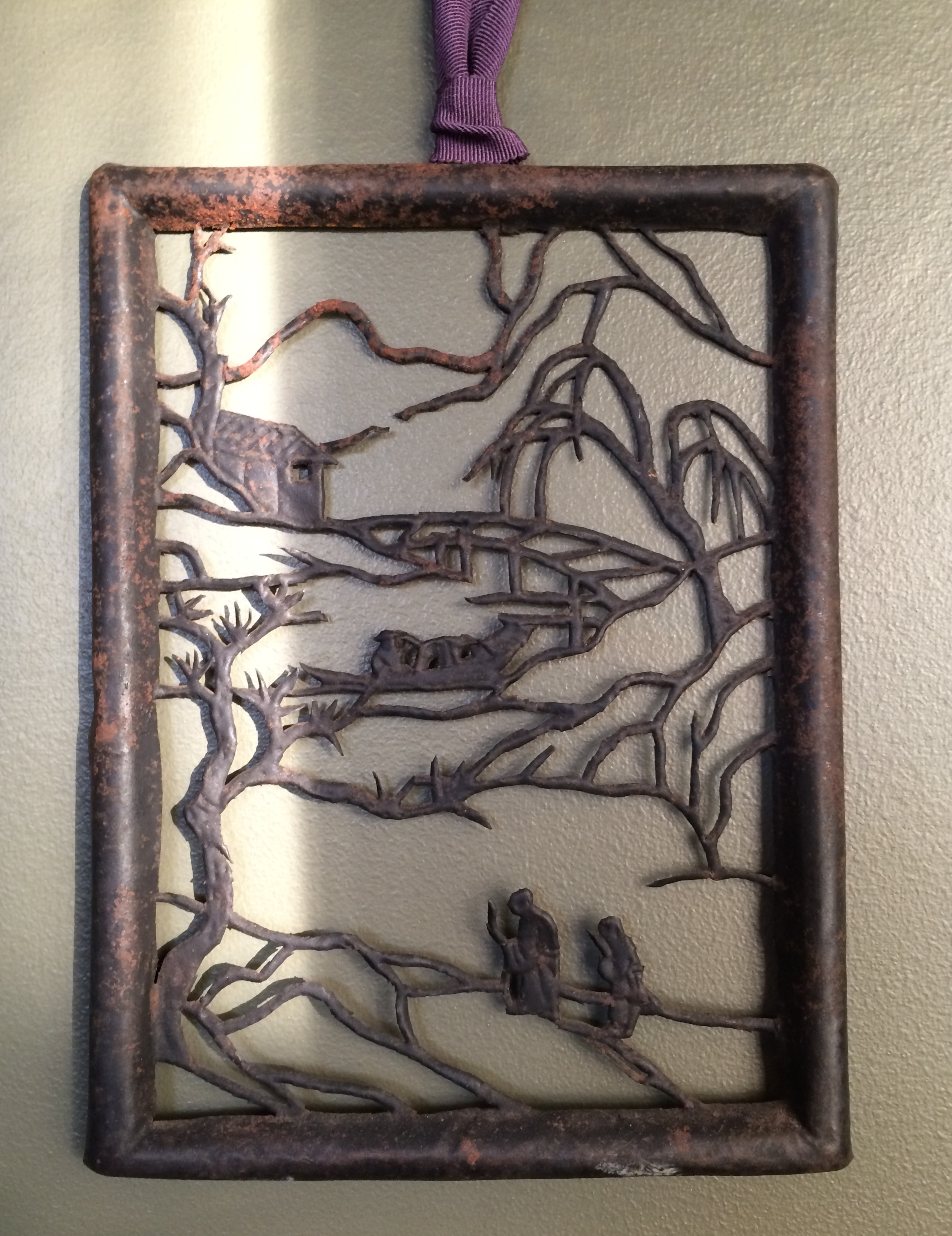 A tiny world rendered in pierced tin.