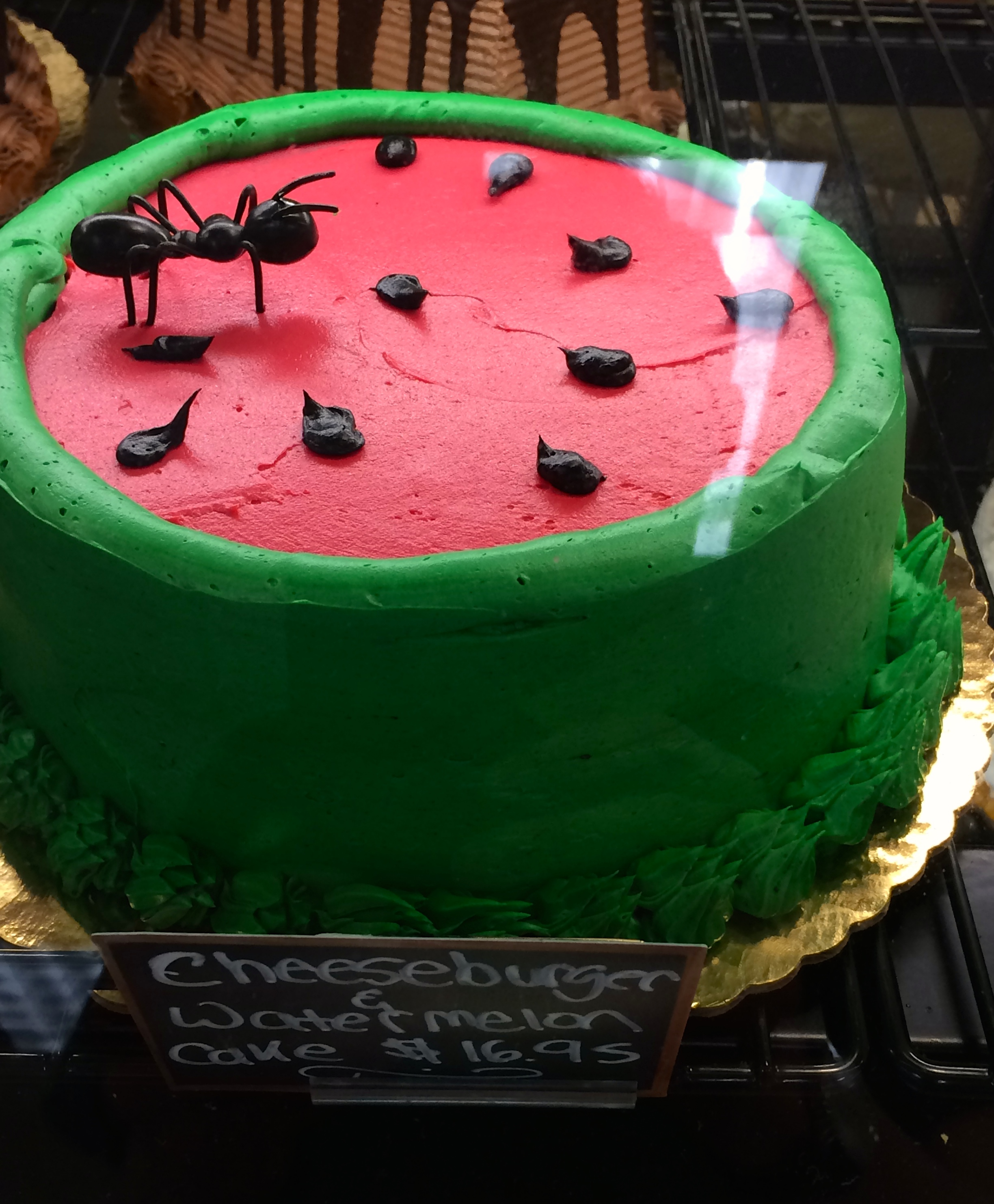 Cheeseburger and watermelon cake. A full meal in a cake, with an ant.