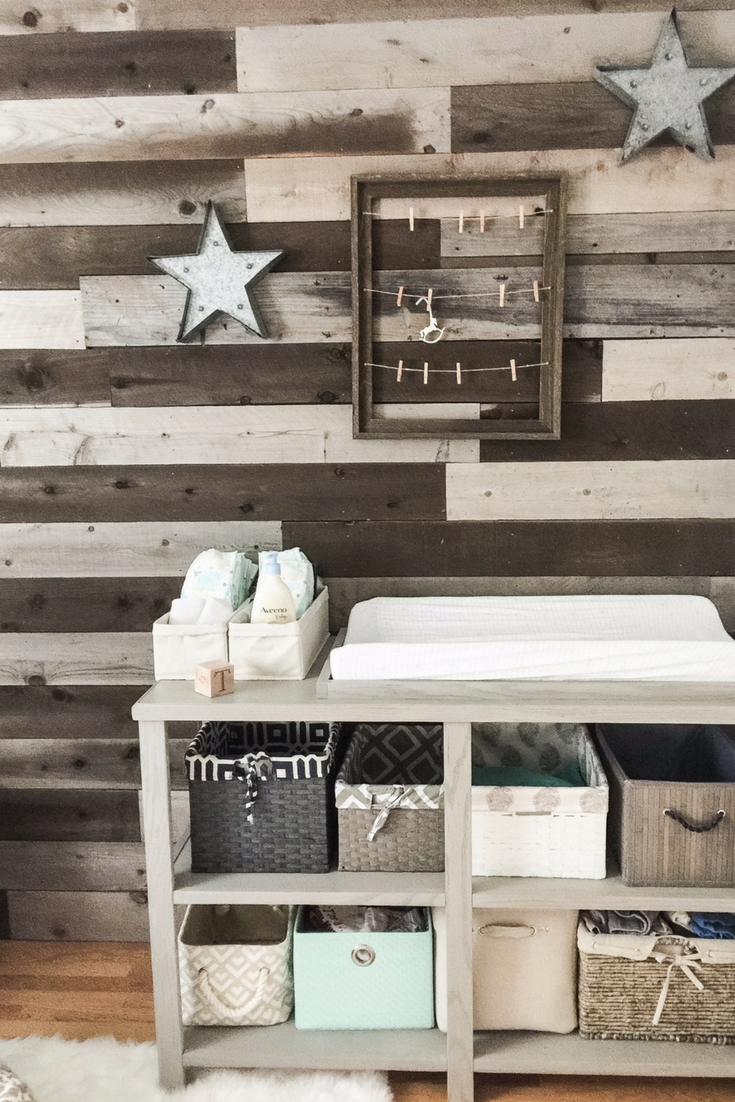 Nursery wooden walls. DIY changing table with baskets. How to design a gender neutral nursery for your baby.