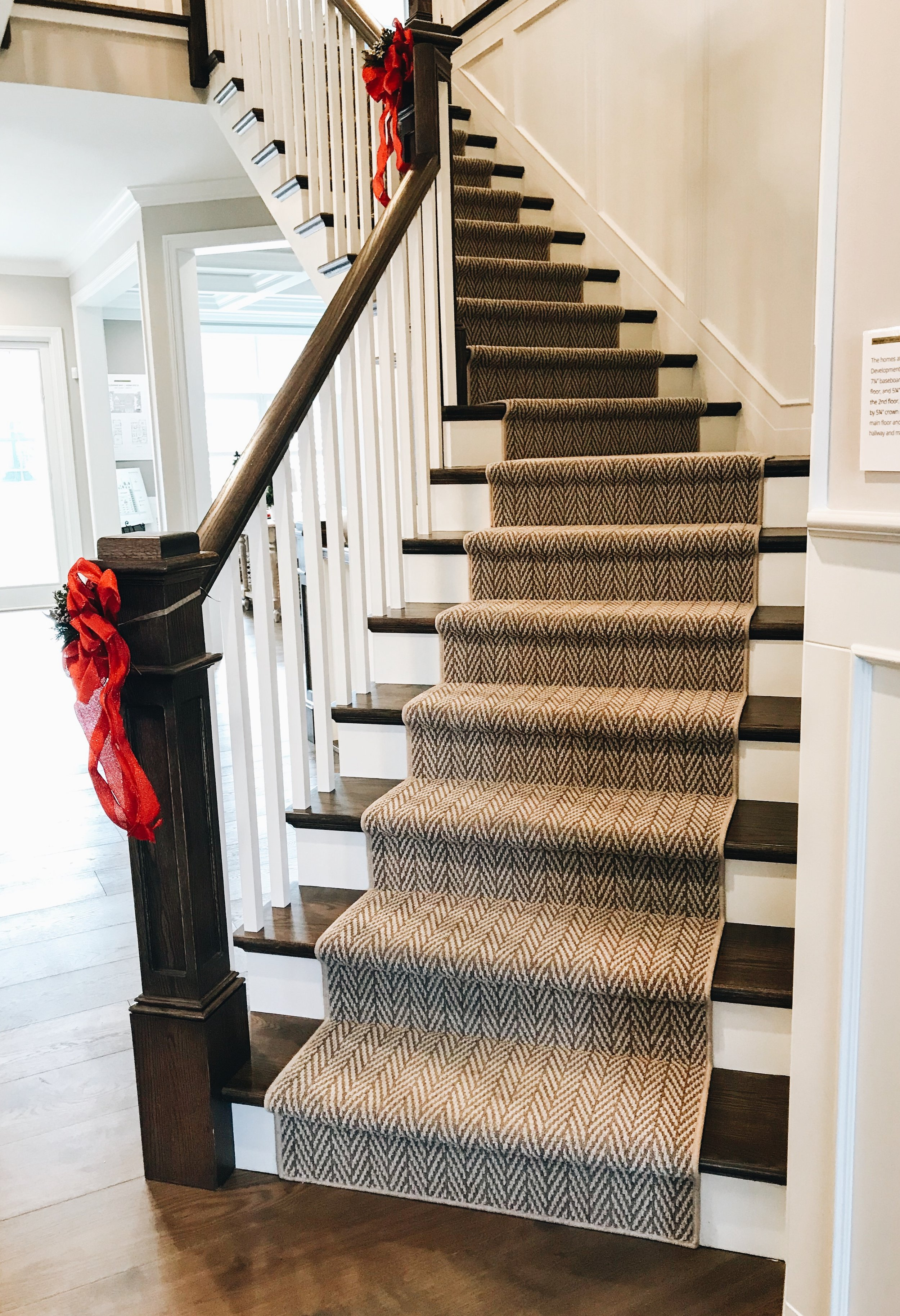 Beautiful Winding Staircase. Runner for stairs. Painted and stained stairs.
