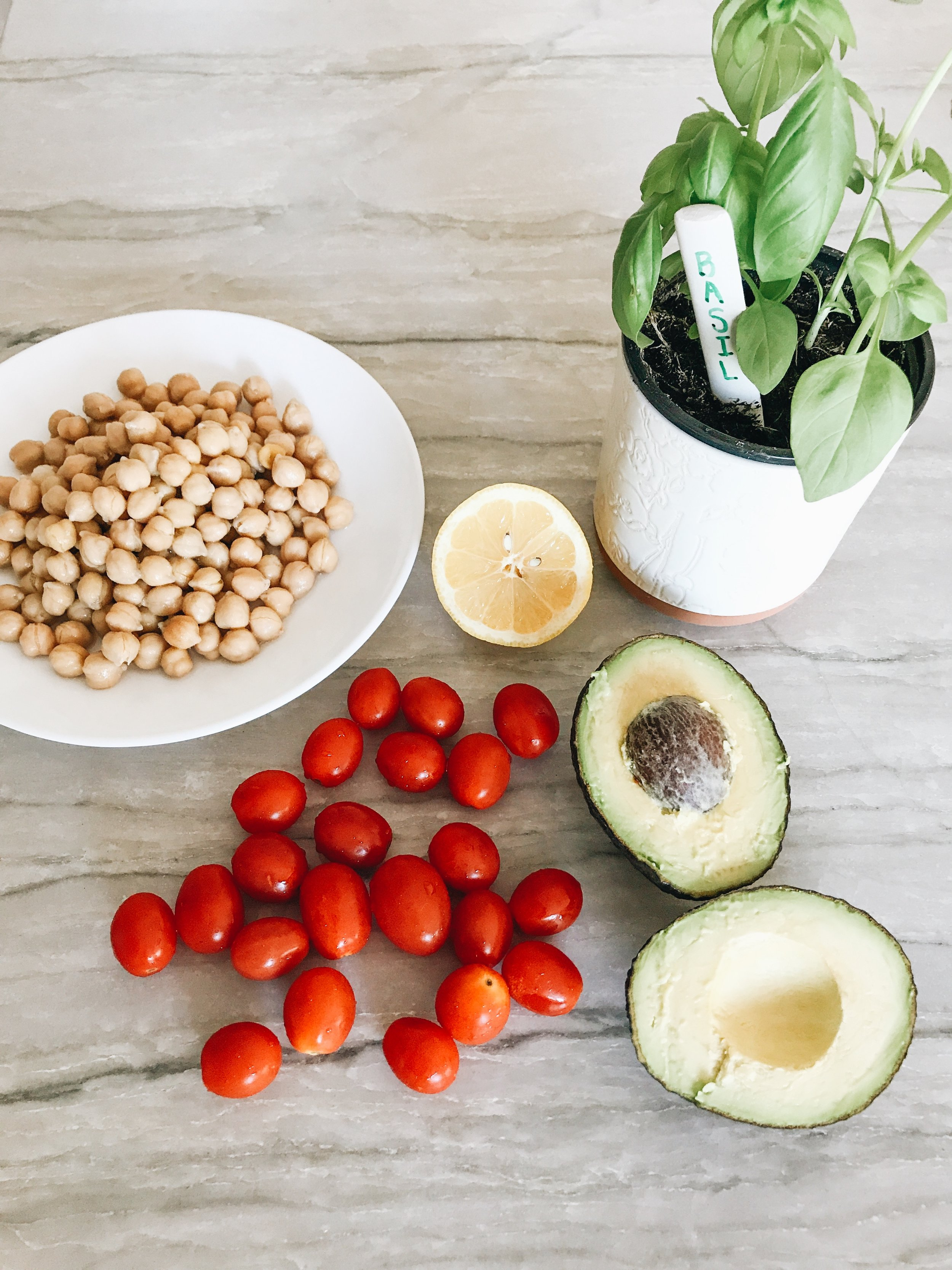 Tomato, Basil, Chickpea, And Avocado Salad with Sparkling Water with Lemon and Blueberries