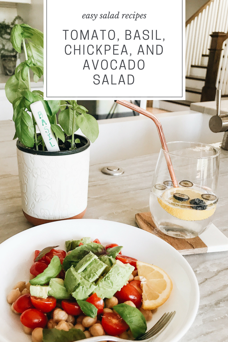 Tomato, Basil, Chickpea, And Avocado Salad and Sparkling Water with Lemon and Blueberries.