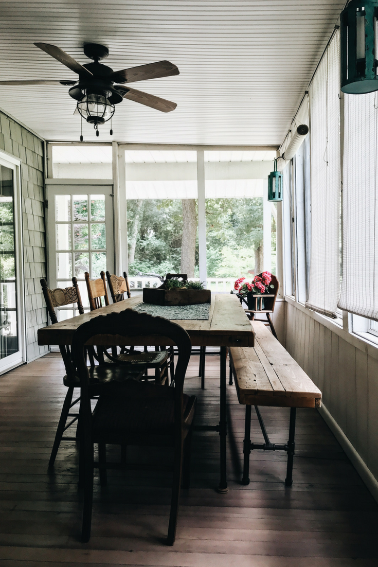 Lake house porch ideas. Kitchen table on porch. Dining area on porch. Reclaimed wood table. Barnwood kitchen table with bench.