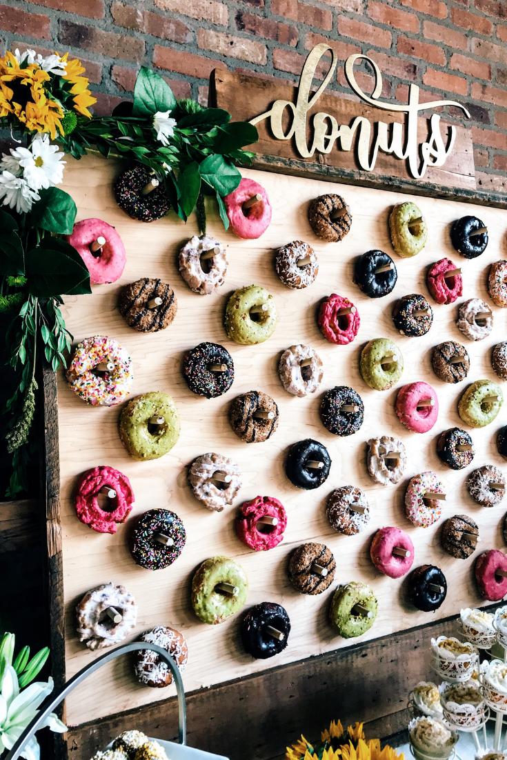 Donut Wall Dessert Table Ideas. How to create a donut wall. Donut wall for wedding or birthday party. Gourmet Donut Wall Ideas. Donut cake instead of wedding cake.  #donut #wall #ideas