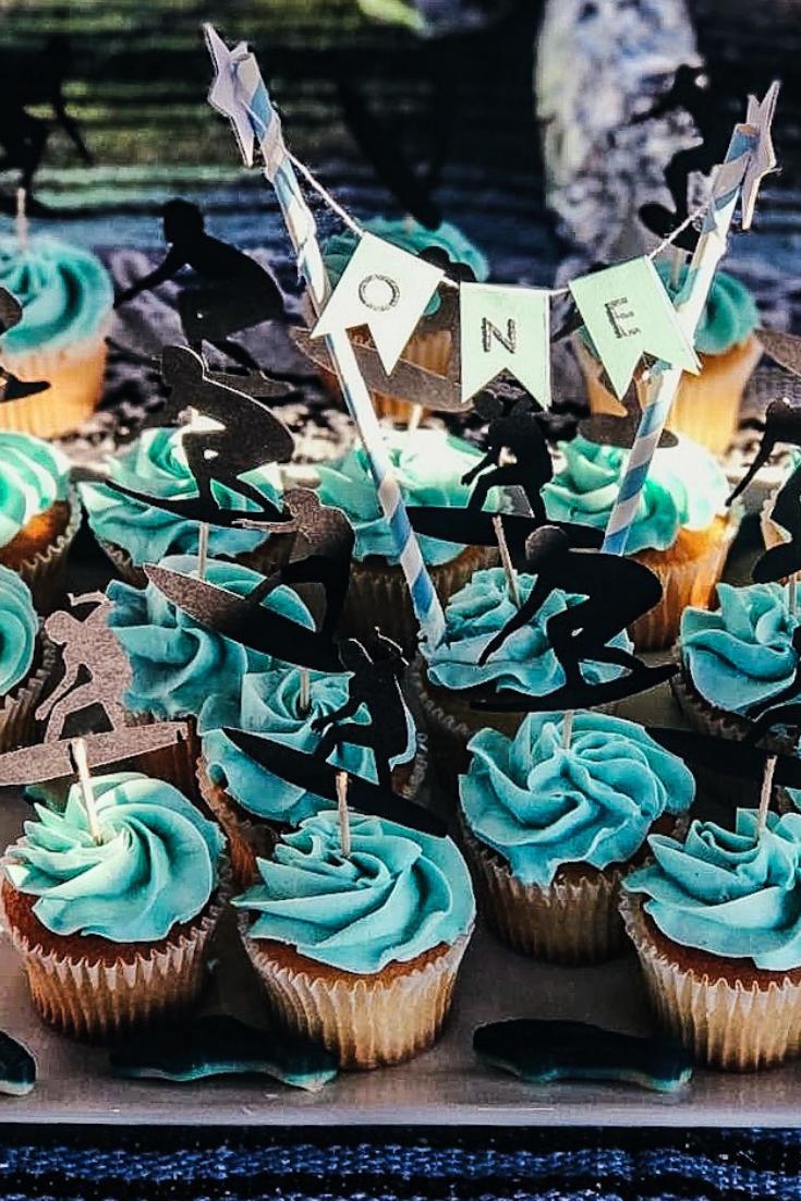 Surfer Themed Birthday Party Dessert Ideas. Beach Themed Cake Ideas. Southern California Party Decor. Surfer cake and cupcake ideas. Ocean themed dessert table. Surfer first birthday party. Surfboard Cake Ideas. Surfboard cupcakes. #surfer #birthday #cake #surfboa