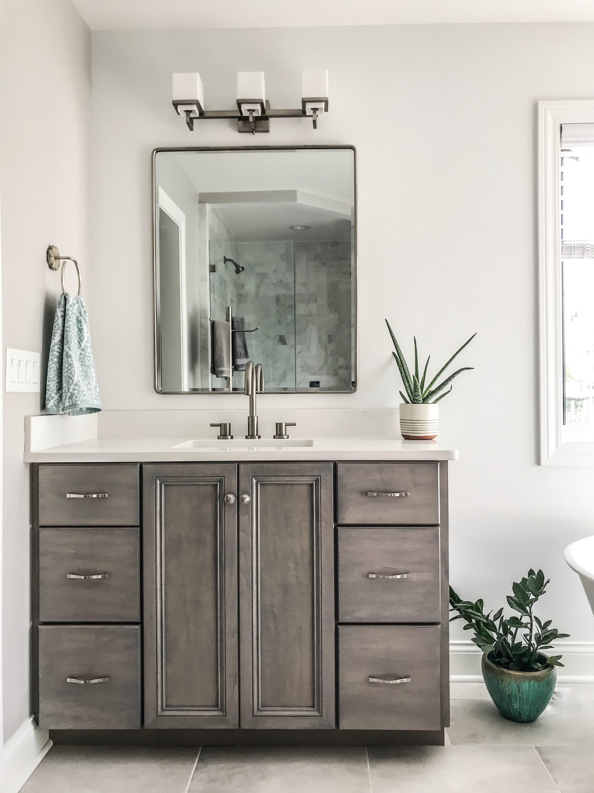 Modern Bathroom Vanity Ideas. Modern Bathroom Design. Bathroom mirrors. Gray Master Bathroom. House plants in bathroom. Freestanding bathtub. #wetstyle #sponsored #bathtub #vanity #mirrors