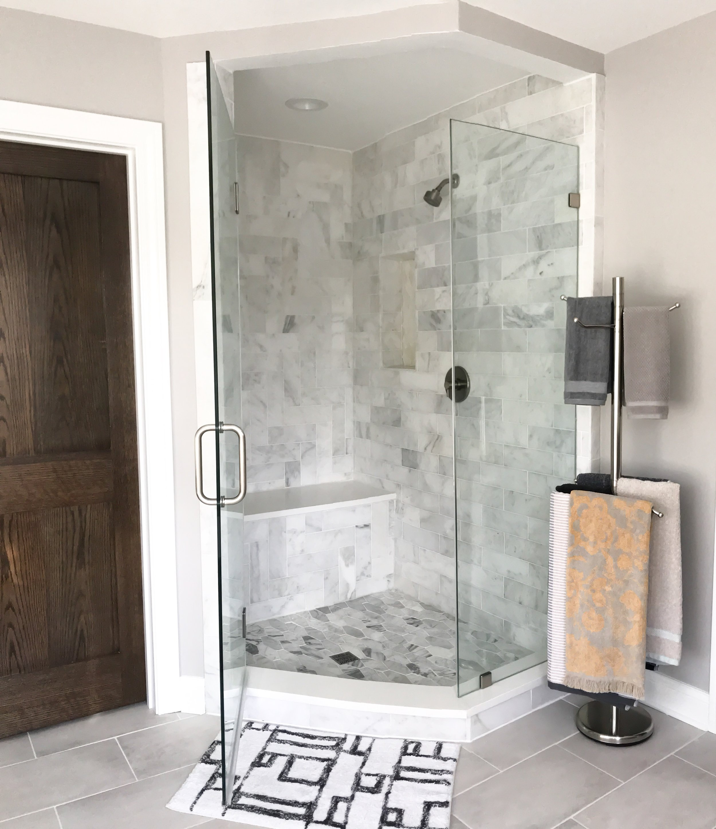Master Bathroom Shower Ideas. Freestanding towel rack. Glass shower doors. Glass Modern Shower. Designing A Master Bath. Bathroom remodeling ideas. Modern bathroom design. New bathroom construction. Master bathroom freestanding tub and marble shower ideas. #wetstyle #sponsored #newconstruction #modern #master #bathroom