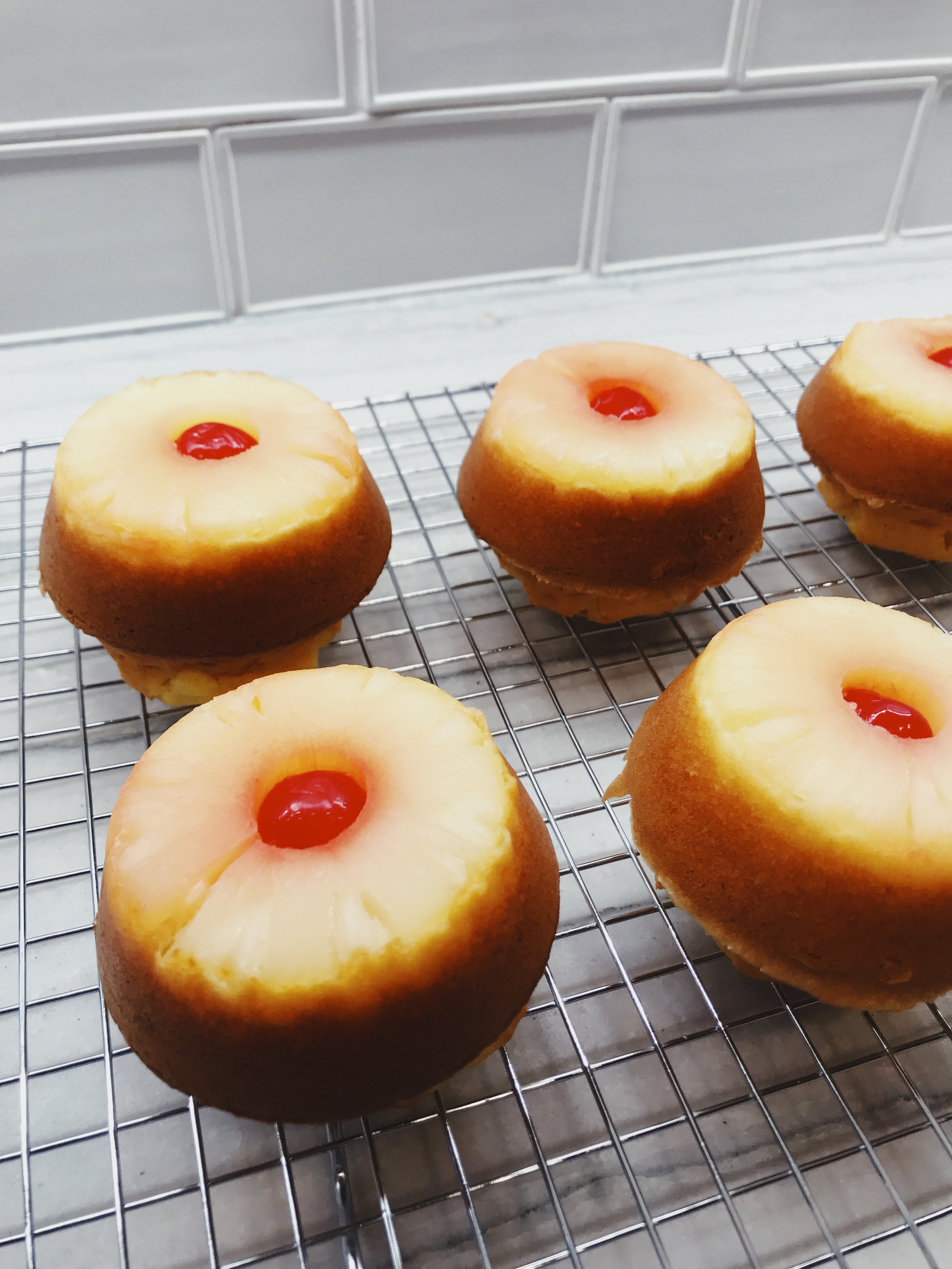 Pineapple upside down cake recipe ideas. Pineapple cake rolled in chopped pecans and coconut. Baked using Metallic Bakeware pans. #sponsored #upside #down #cake Holiday cookie recipes. Making memories in the kitchen with your kids. How to make browned butter pecan pretzel cookies and upside down pineapple cakes using Chicago Metallic bakeware. Best bakeware for the cookies, cakes, and muffins. #sponsored #chicago #metallics #holiday #cookies