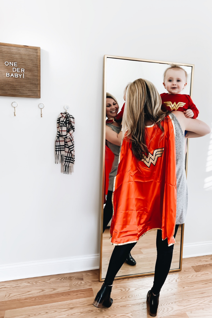 Mommy Daughter Wonder Woman Costume Ideas. Wonder Woman Cape and Onesie. Superhero birthday day party. Wonder Woman Onesie. Wonder Woman Superhero Birthday Party Theme Ideas. How to Plan a Wonder Woman Themed 1st Birthday Party. #sponsored #wonder#woman #birthday #party #decor