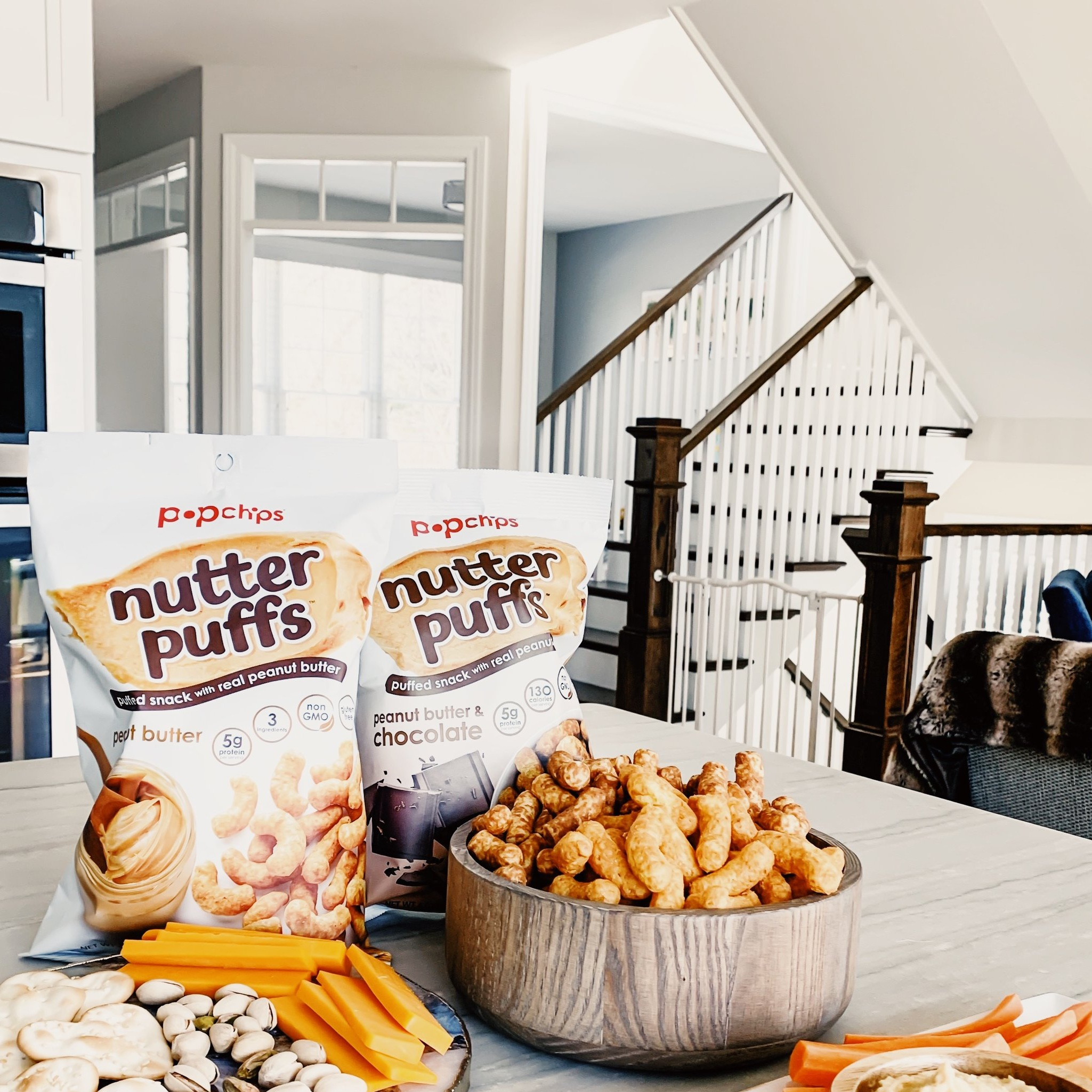 Easy Snack And Appetizers Ideas For a Lunch-Time Gathering. nutter puffs - delicious gluten-free, non-gmo, vegan snack option for any part of the day. nutter puffs by popchips. Indulgent peanut butter snack ideas. #ad #popchips #spreadthelove #nutterpuffs #snack #ideas