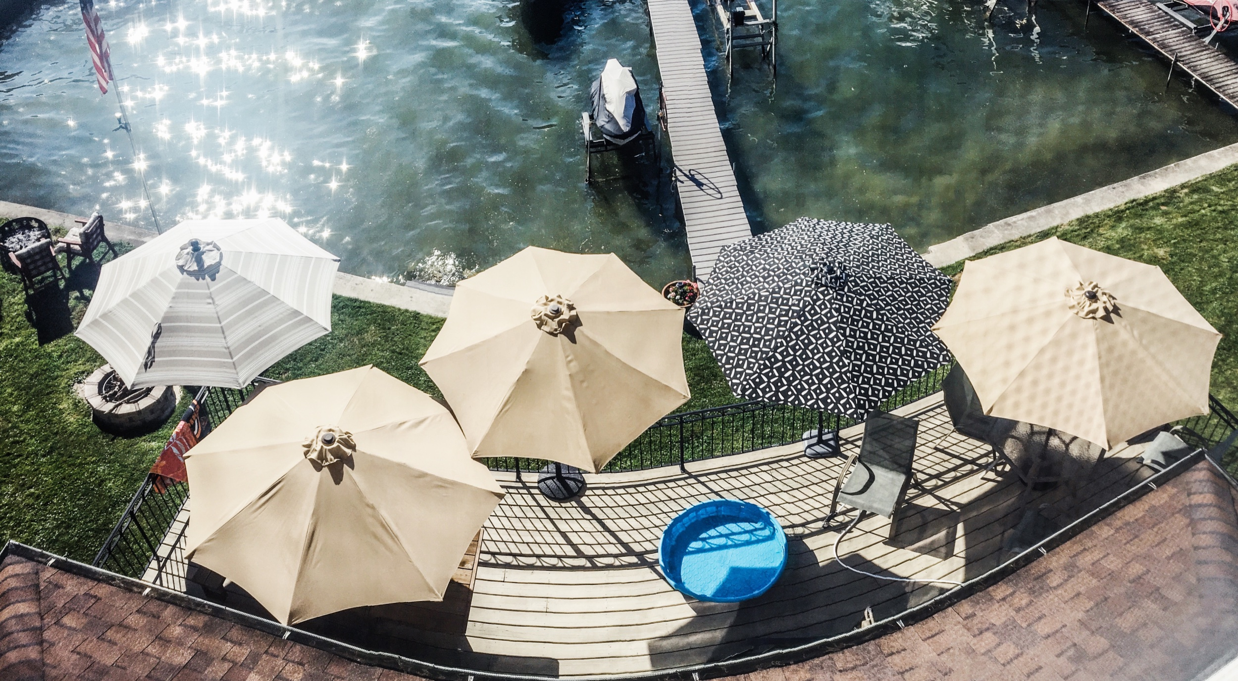 Lake house umbrella ideas. How to cover a lake house deck with shade. How to get shade to a full sun deck. How to get lake house deck shade. Best umbrellas for lake house deck.