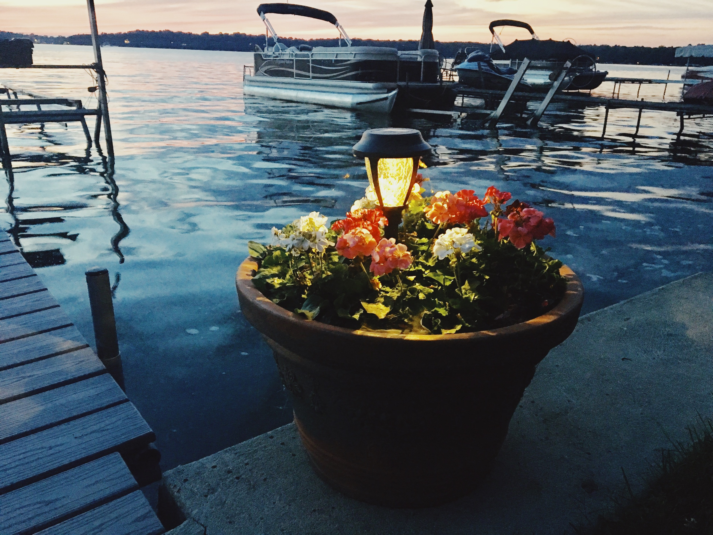 LED Solar Pathway Lights on a dock. Seawall lights. Flower pot LED lights. Dock lights for a lake house. Lake house dock lights. Lit dock at night. Outdoor light ideas for a dock. #Dock #light #ideas