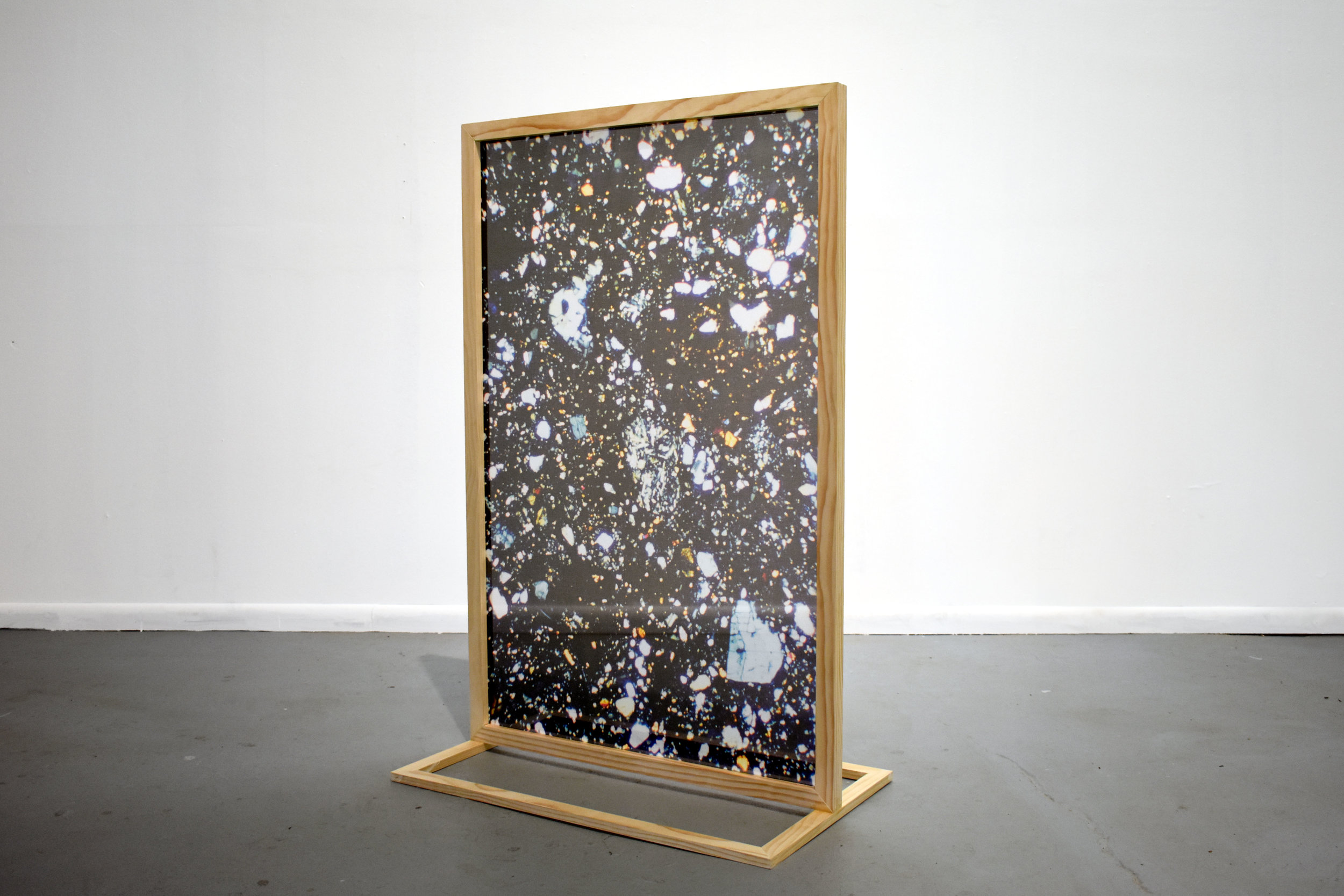 Stand and Slide , 2018  Moon breccia thin sections viewed through polarized light, digitally printed on silk chiffon, free-standing wood frame