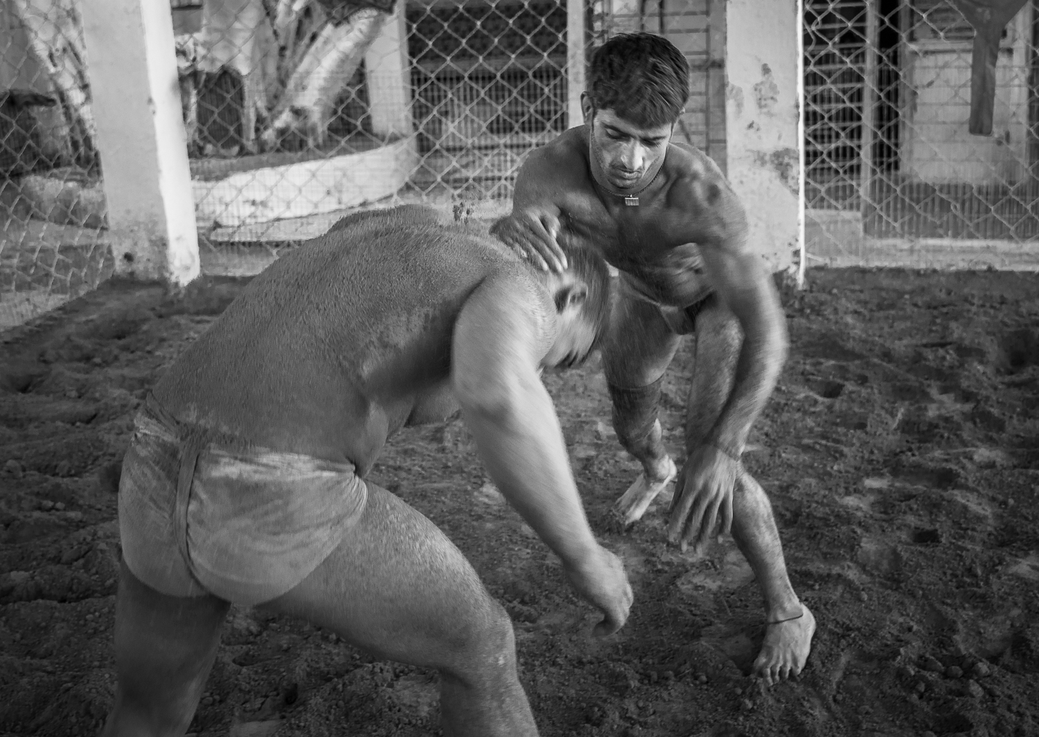 © Ayash Basu. Wrestlers immediately go after the opponent's head and neck in an effort to pin him down and gain a stranglehold. Traditional  malla-yuddha  emphasizes on this attack; the Moghuls introduced better footwork and ground movement techniques to the sport. No hitting, kicking, slapping is allowed in kushti.