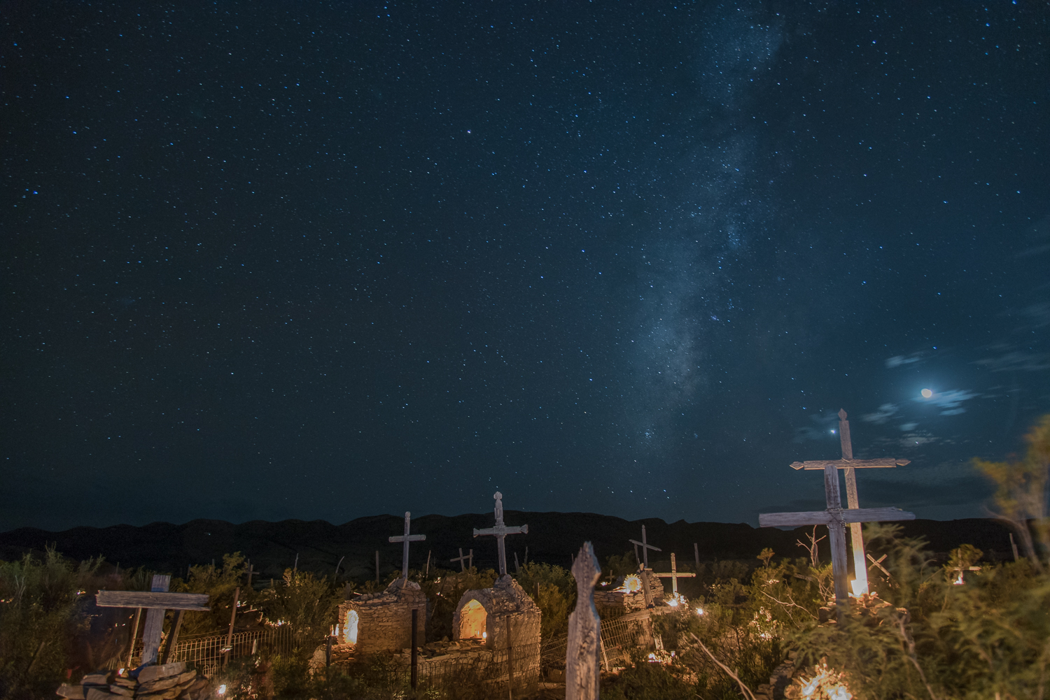 © Ayash Basu. Over 400 candles, millions of stars and an occasional moon keep the Terlingua cemetery lit up throughout the night. It's one dreamlike sight.