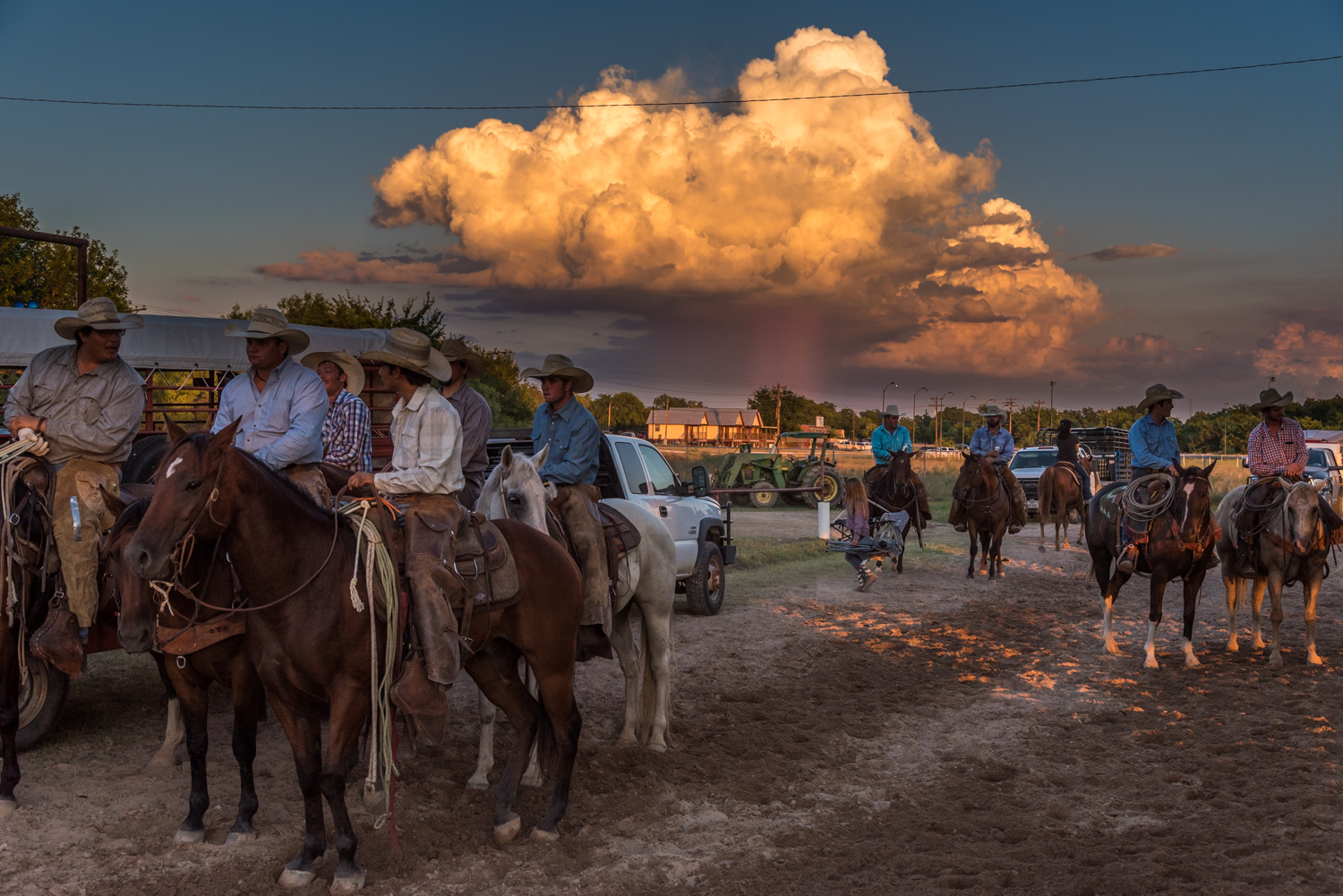 © Ayash Basu. Rodeo arena perimeters round up as perfect socializing grounds for rodeo men who share beers and catch up in between events. Bandera 2018.
