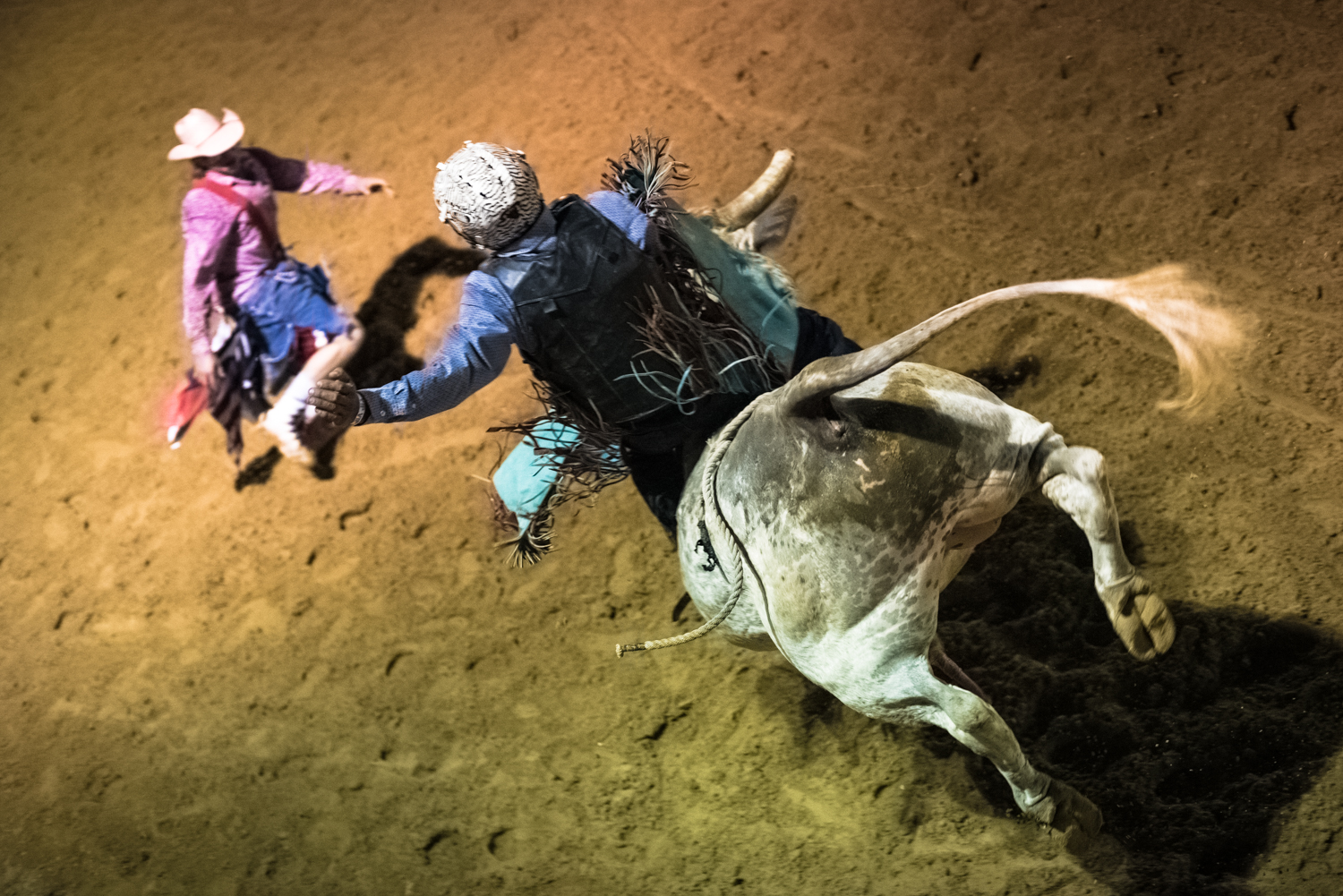 © Ayash Basu. A good bull ride means big cash earnings in one rodeo night, making the risks seemingly worthwhile to riders. Boerne 2018.