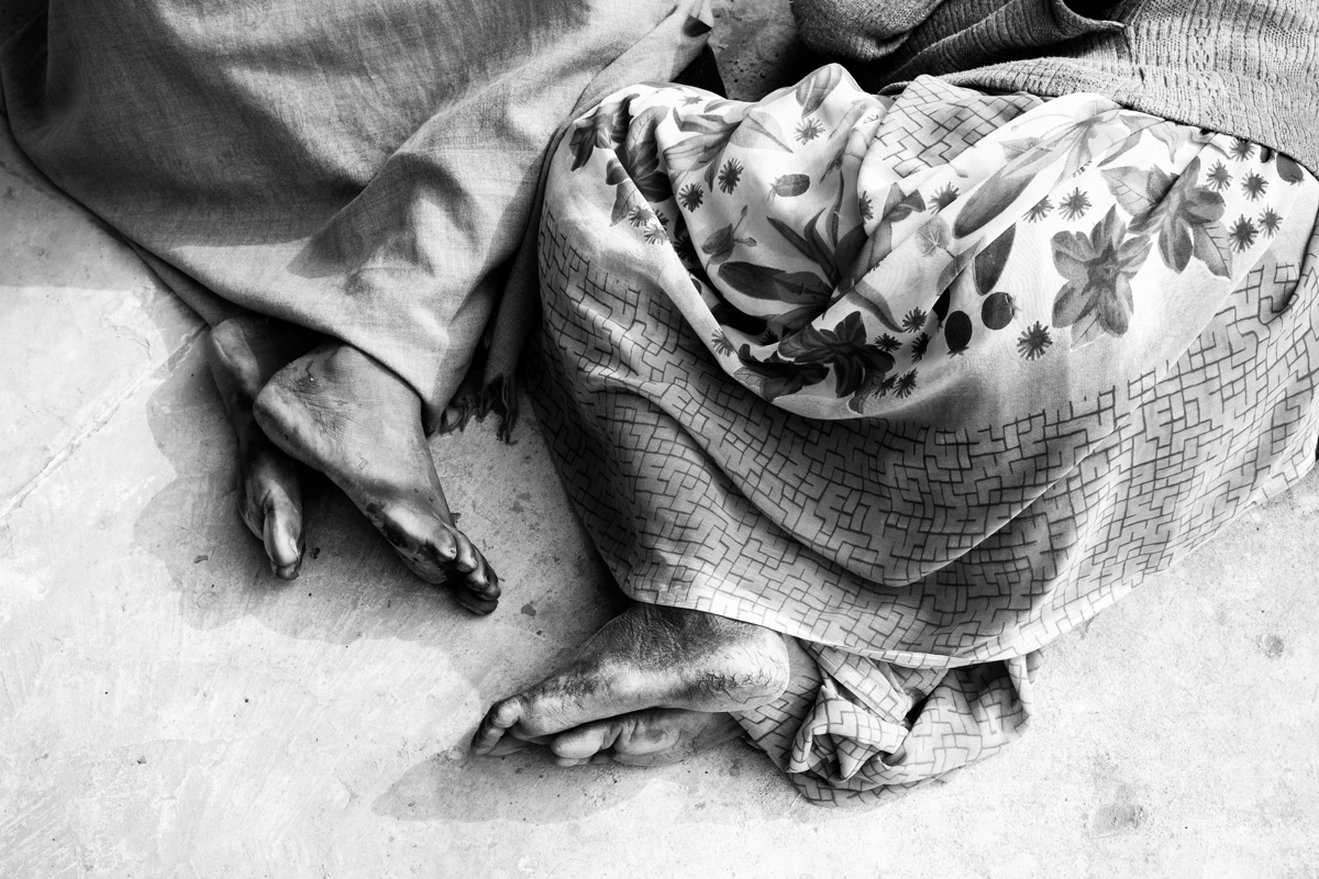© Ayash Basu. Weary feet at rest. I was at the Kumbh for 6 days with no pilgrimage intentions and still ended up walking 120K steps over 42 miles according to my iPhone's Health app. That's an average of 20K steps and 7 miles a day. These feet have done way more than that for much longer, without proper footwear - only to realize a belief and a desire for a dip in the holy waters of the Sangam.