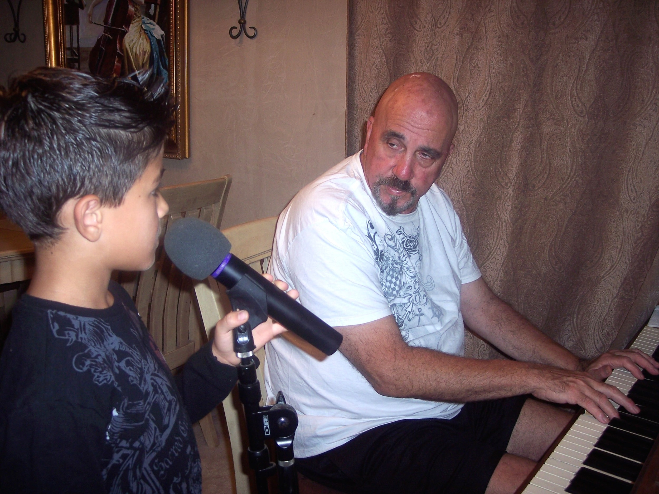 TECMEF founder Rich Pulin and grandson Jovanny working on song