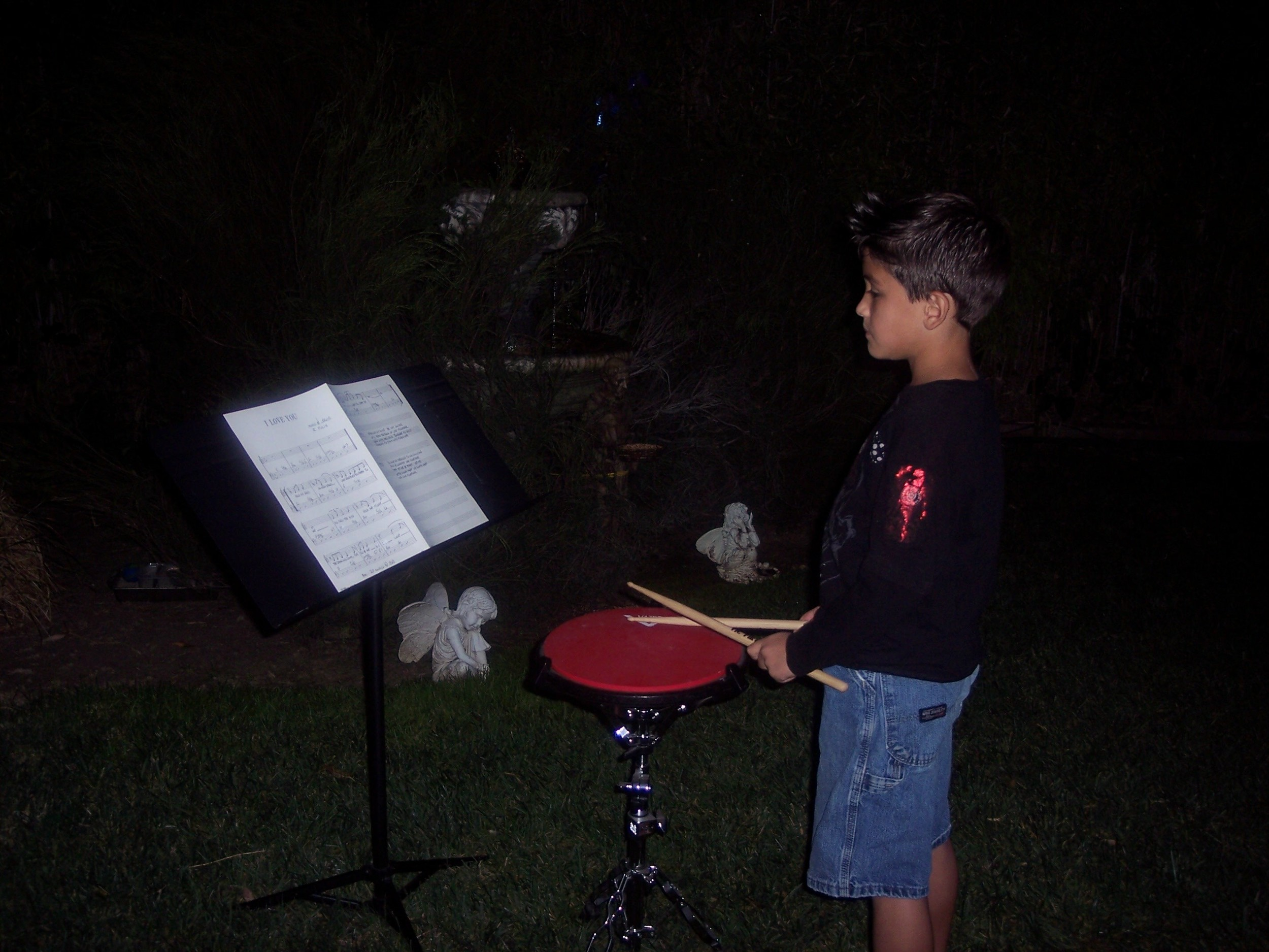 Grandson Jovanny reading music and practicing drum pad