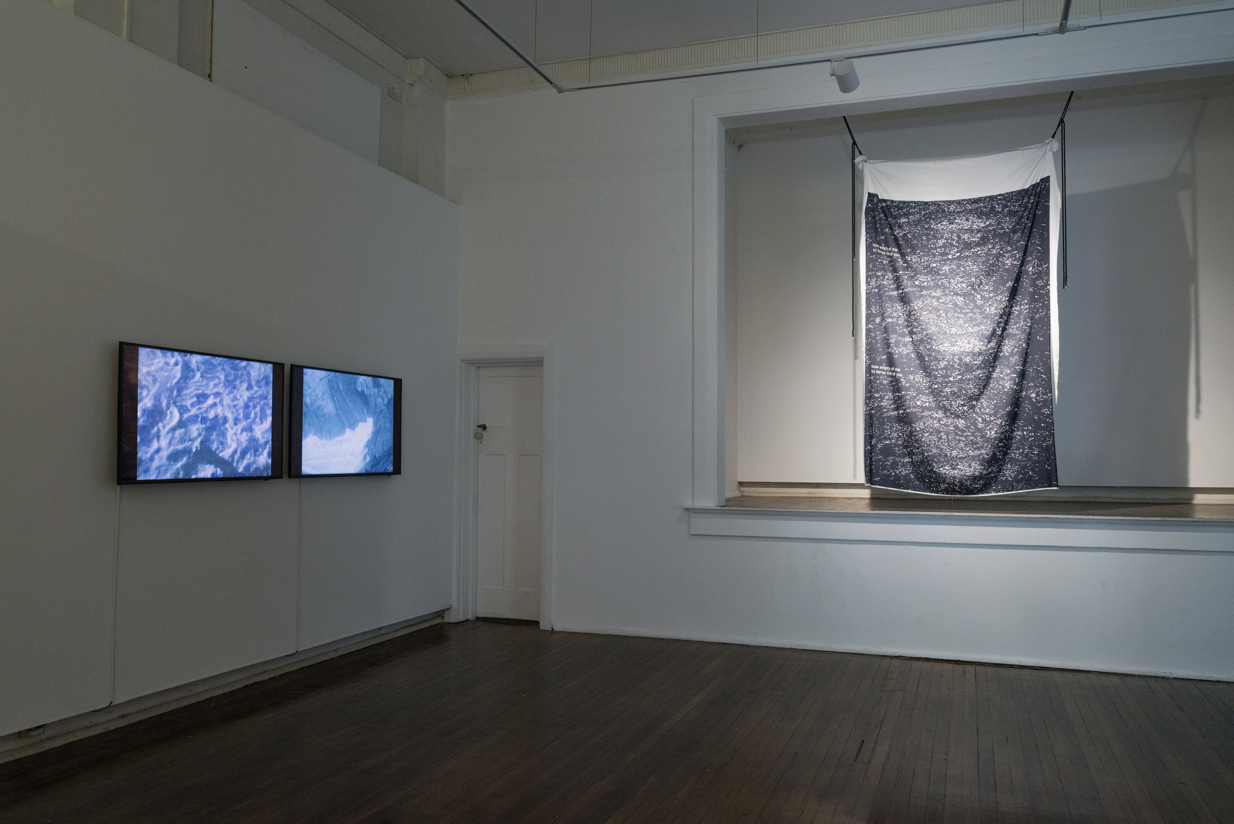 L > R    w-a (the waves) / w-a (the lamp)  . 2018. (install view). two-channel video. 00:05:13  https://vimeo.com/284685326 / https://vimeo.com/284686133    how empty of me to be so full of you  . 2018. (install view). digital print on polysilk with cord. 2000mm x 1350mm   all photo credit: Nick Shearer
