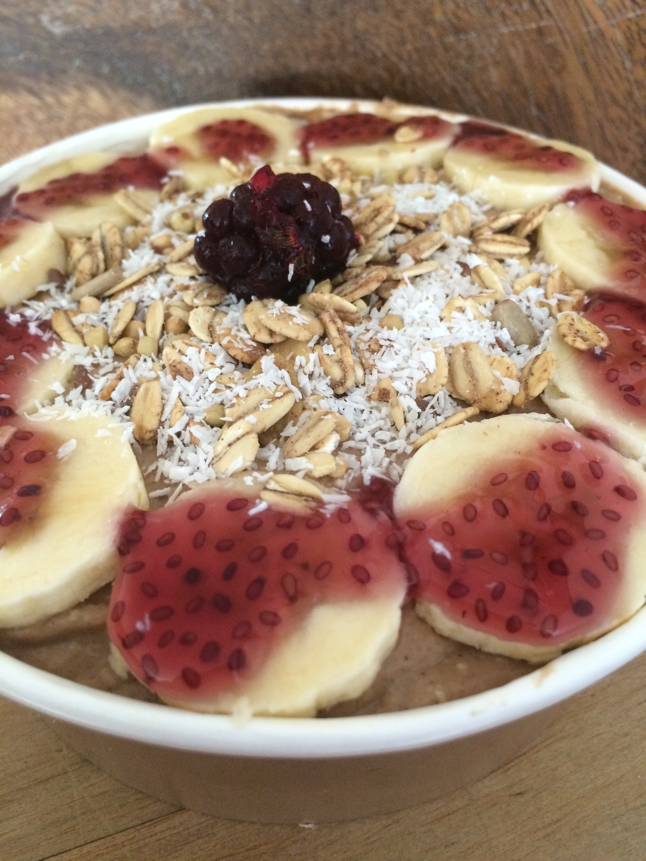 Our cacao bowl topped with a blueberry and apple chia jelly sauce