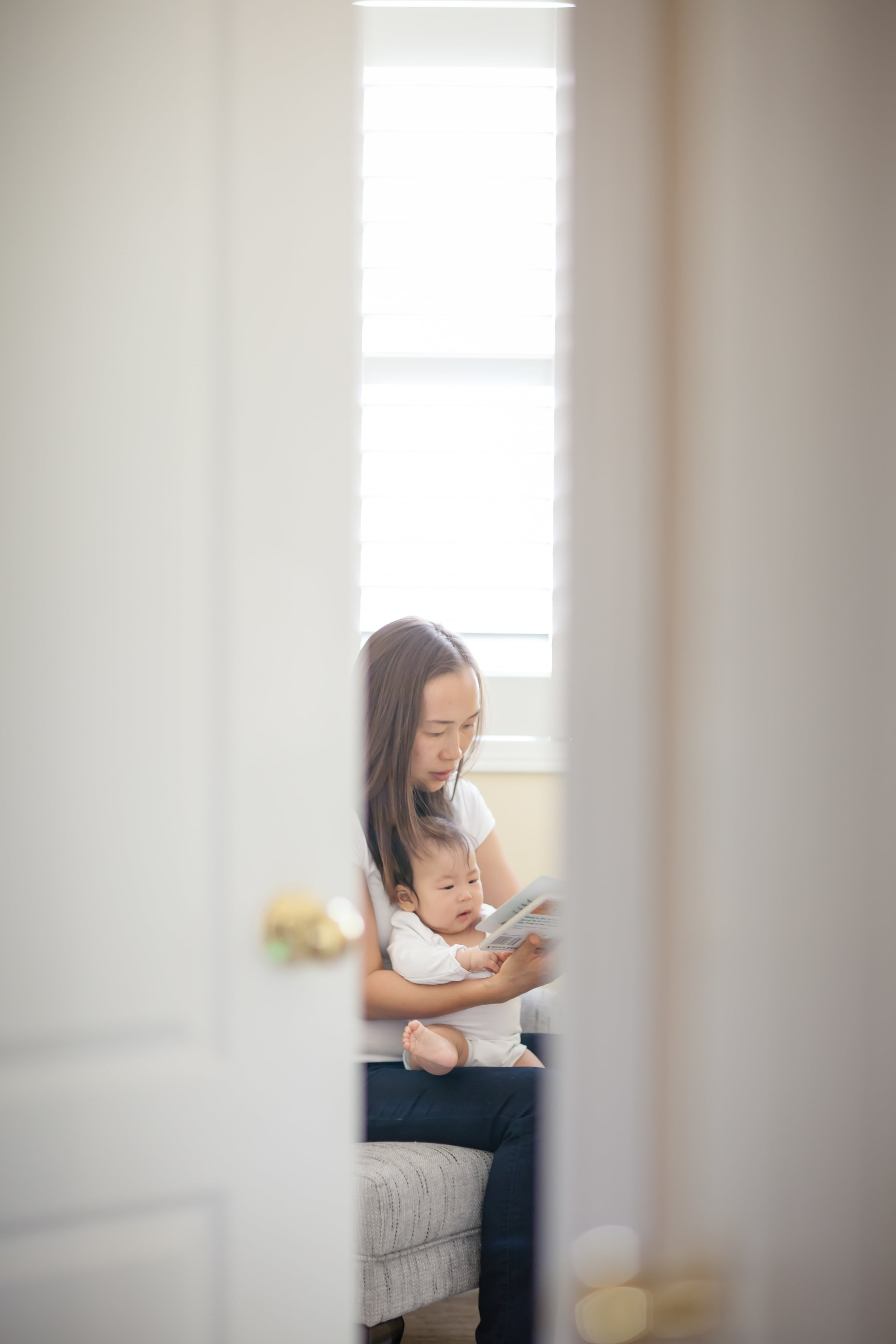 Mother reading story to baby - Sunday Kind of Love baby photographer