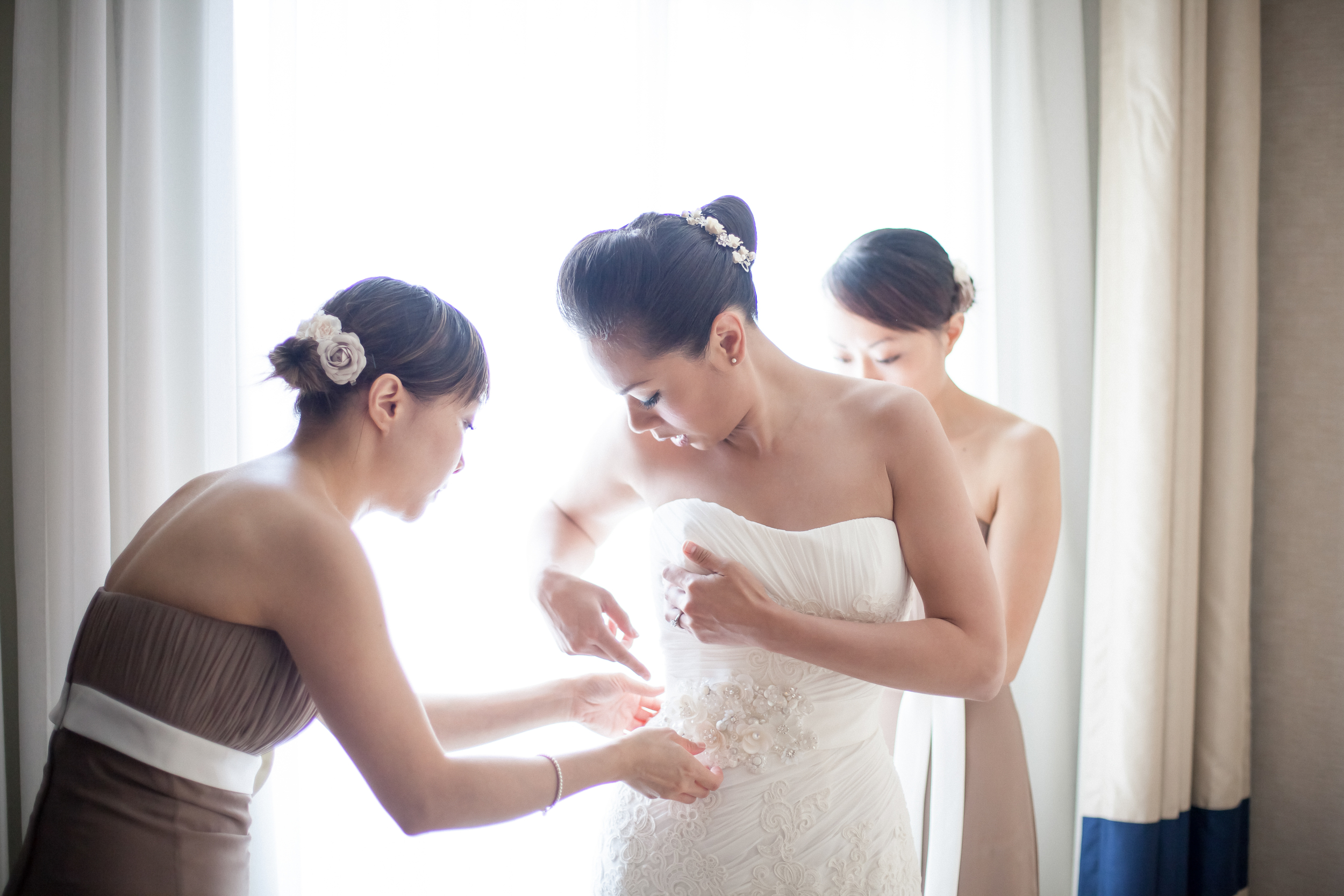 Bride and bridesmaids getting ready in a hotel