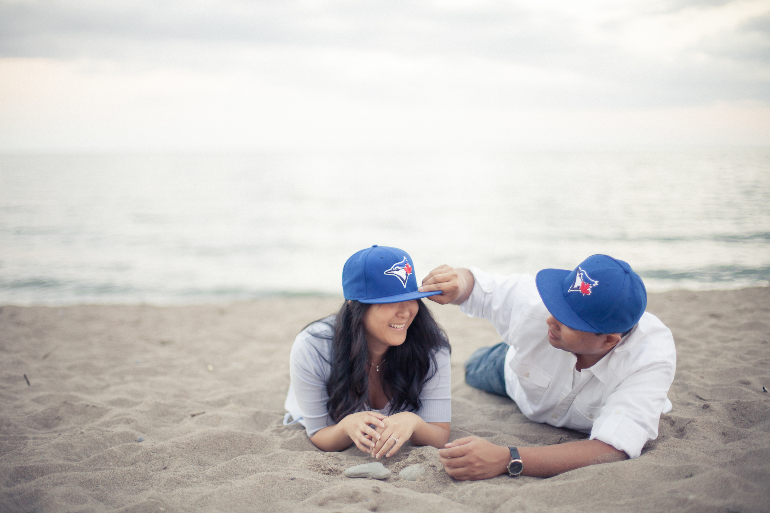 Cherry Beach engagement session with Blue Jays hats