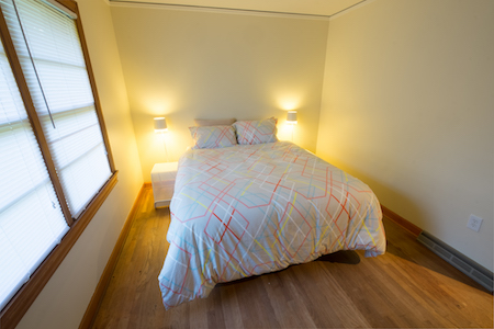 Jane Room - The Jane Room has a queen size bed and a dresser. This is a handicap accessible room and shares the accessible hall bath with roll in shower. Access to living room, community kitchen, outdoor decks and hot tub. Sleeps 2. Nightly rates start at $70.