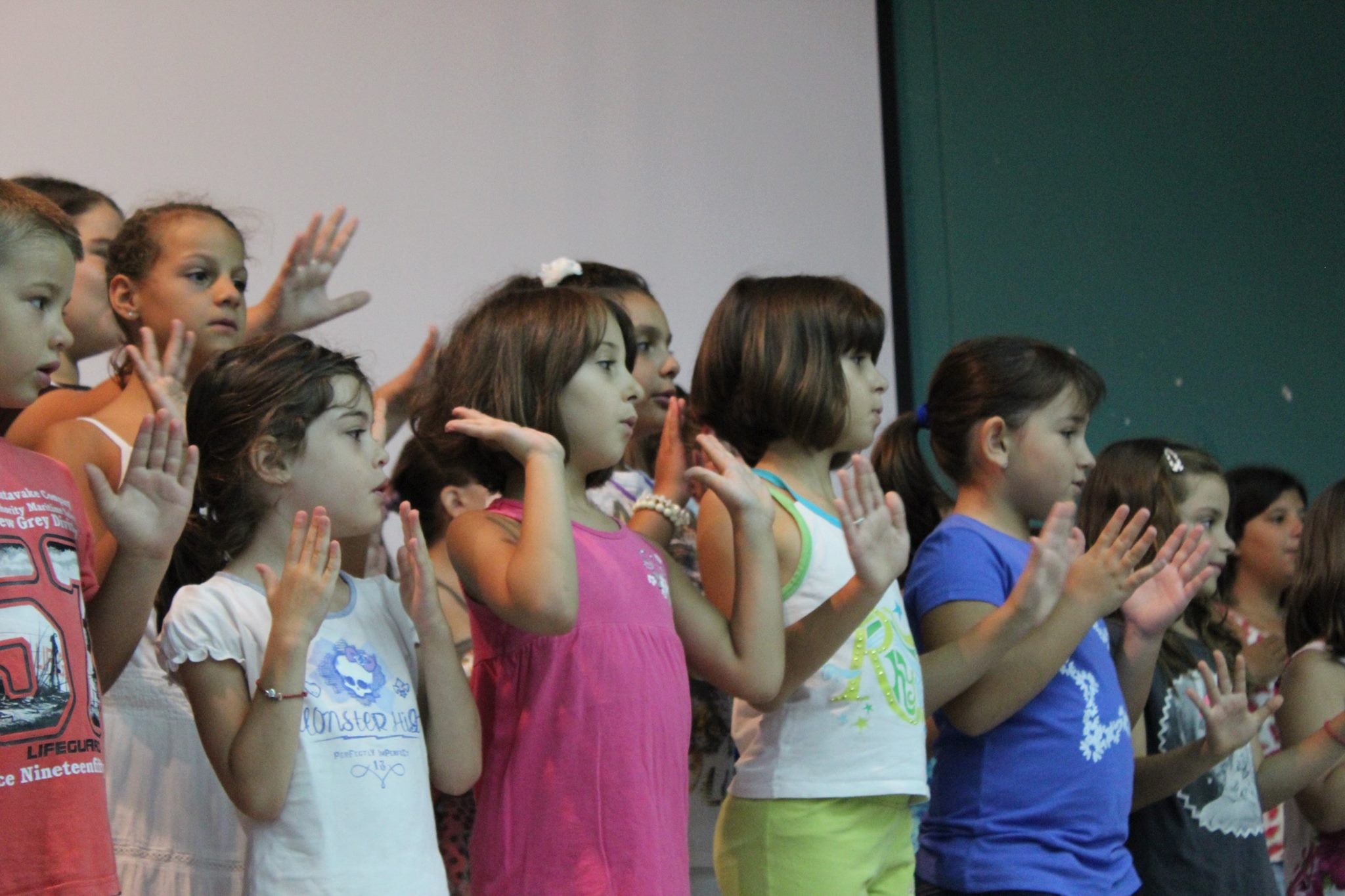 Children from Karlovasi, Samos, participating in a group percussion exercise with Aristea Mellos and Ensemble Ritsos in 2015