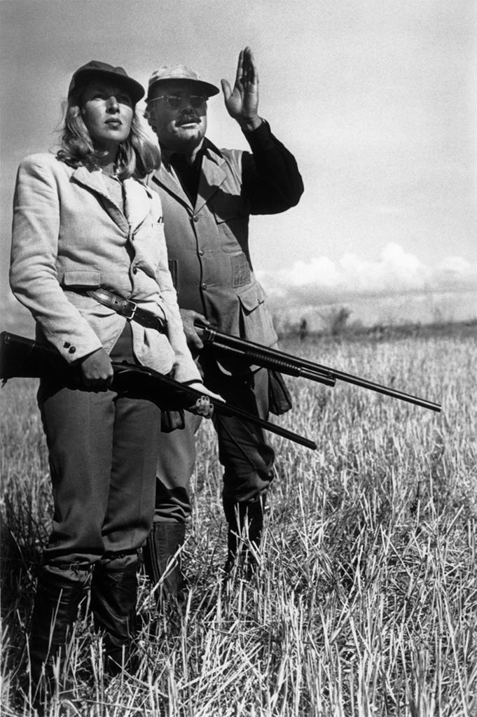 Martha Gellhorn with her then-husband Ernest Hemingway, pheasant hunting in Sun Valley, ID, 1940. Photo by Robert Capa/Magnum Photos.