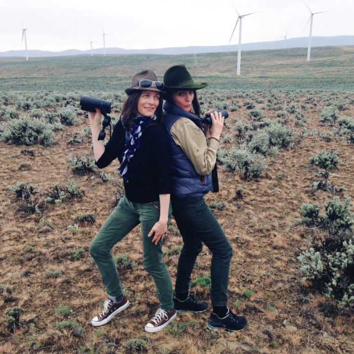 "Gilia and I doing our goofy ""We Rock!"" (Charlie's Angel(l)s, anyone?) after spotting the pair of horned larks at Whiskey Dick Wildlife area. The wind turbines are a recent addition to this stark landscape, and are a mixed bag for birds, more about that later."